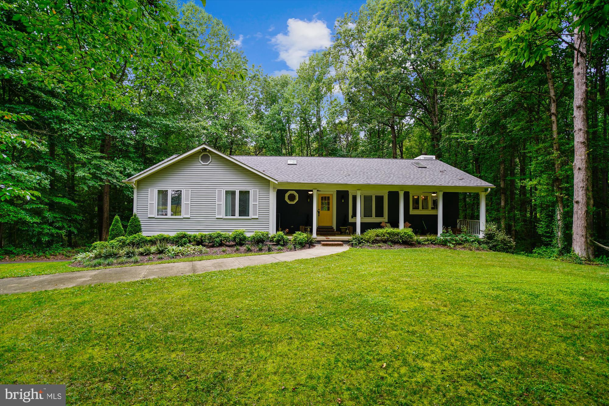 OPEN HOUSE SAT. 9/5 1-3 PM Straight out of Country living! This is the best location just over the Davidsonville line, so convenient to Rt 50, less than 1/2 mile to the Exit 16 Rt  Davidsonville Rt. 424 exit.  Located in the Desirable brand new Crofton High school district! Surrounded by nature this small enclave of custom built homes on large lots, Bottners Woods offers privacy between neighboring homes.  Terrific curb appeal this 4 + acre  Magnolia farm stylish ranch home  features a welcoming front porch large enough to enjoy your morning coffee or afternoon lemonade. Step inside and enjoy the amazing natural light filled renovated open living spaces.  Carefully thought out renovations include dark stained oak hardwood flooring on the main level, an open foyer, fabulous Gourmet white timeless kitchen featuring soaring ceilings, shiny stainless appliances, sub way tiled walls, leathered granite countertops and attractive  upgraded lighting. French doors into the library/study, high baseboard trim, upgraded door hardware are small items that make a difference.  The primary suite overlooks the back yard and woods beyond. The primary ensuite includes a walk in closet featuring handsome custom closet organizers. Impressive  with timeless appeal the primary bath renovation includes a frameless sub way tiled tiled shower featuring  a soaking slipper tub and dual sinks, one topped with Carrara marble. Enjoy a spa like relaxing retreat in the privacy of your own home. All three baths have been tastefully updated. The walk out lower level is perfect for the youngsters or visiting guests. Notice the custom trim work in the hallways leading to the 4th bedroom and rec/media room.  A secret sweet play house exists under the staircase.  A newer super efficient hot water heater keeps the utility bill at a minimum.  Recent roof replacement, gutters, gutter guards and Trane seer 14 furnace installed  for peace of mind. This home is move in ready not much to do but un pack and  enj