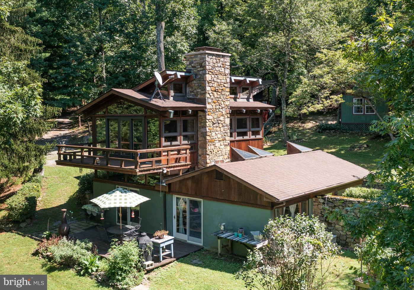 This outstanding custom contemporary mountain home with two bedrooms, two baths, and a guest cottage