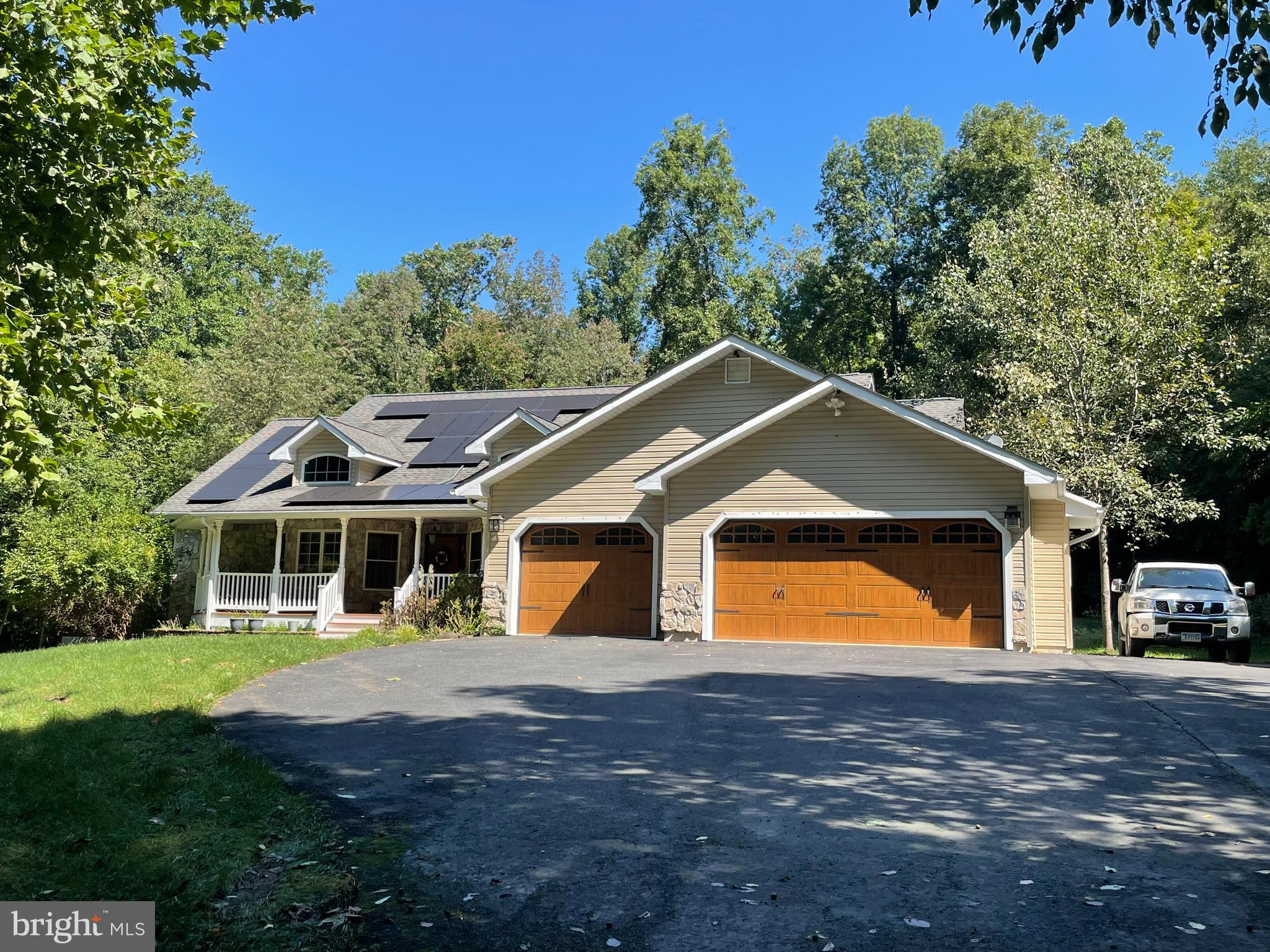 This gorgeous  3 bedroom , 2.5 bath , 3 car garage rancher is nestled on approximately 5 acres of la