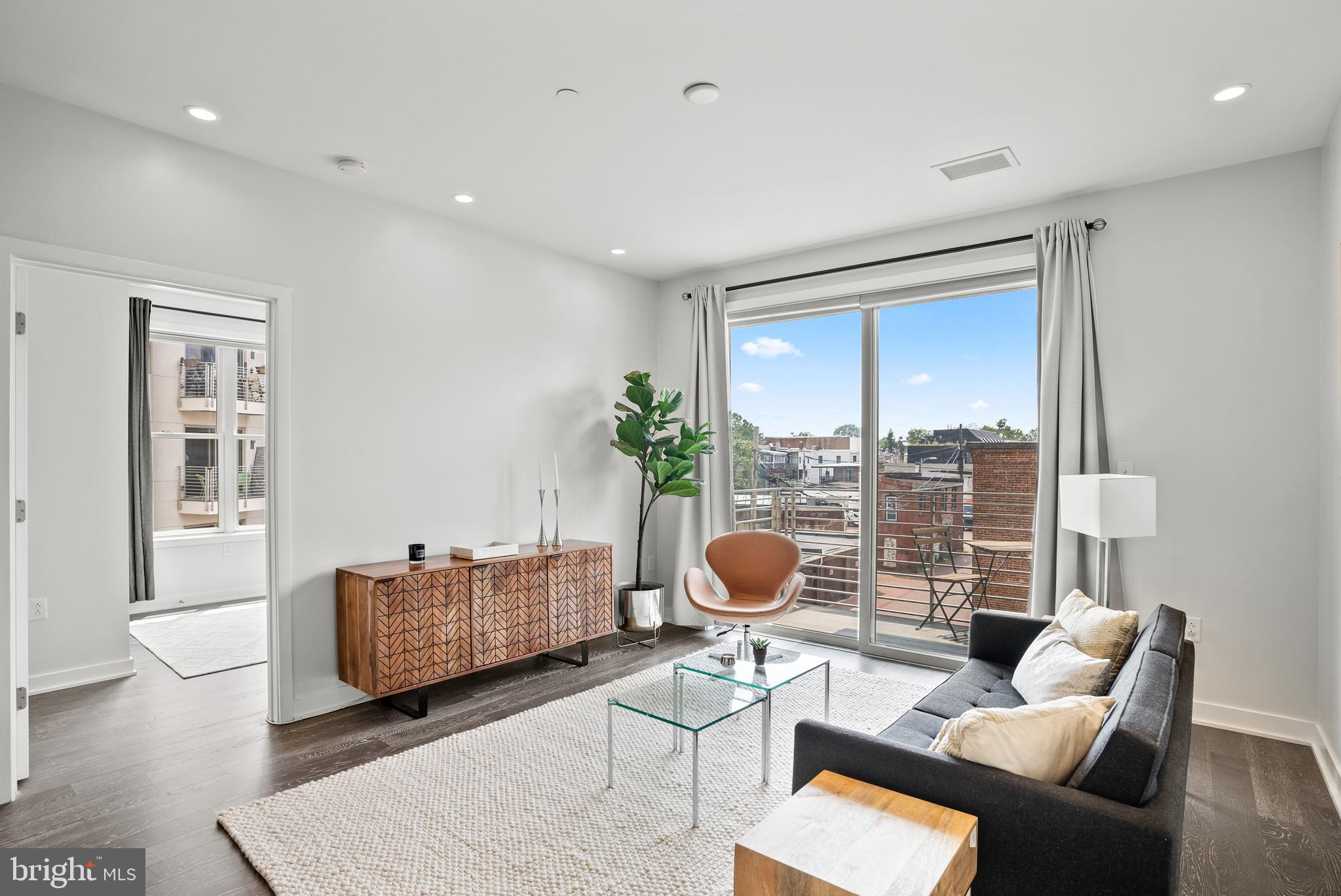 Enjoy this rarely available corner home at The Maryland Condominiums, located in the H Street Corrid