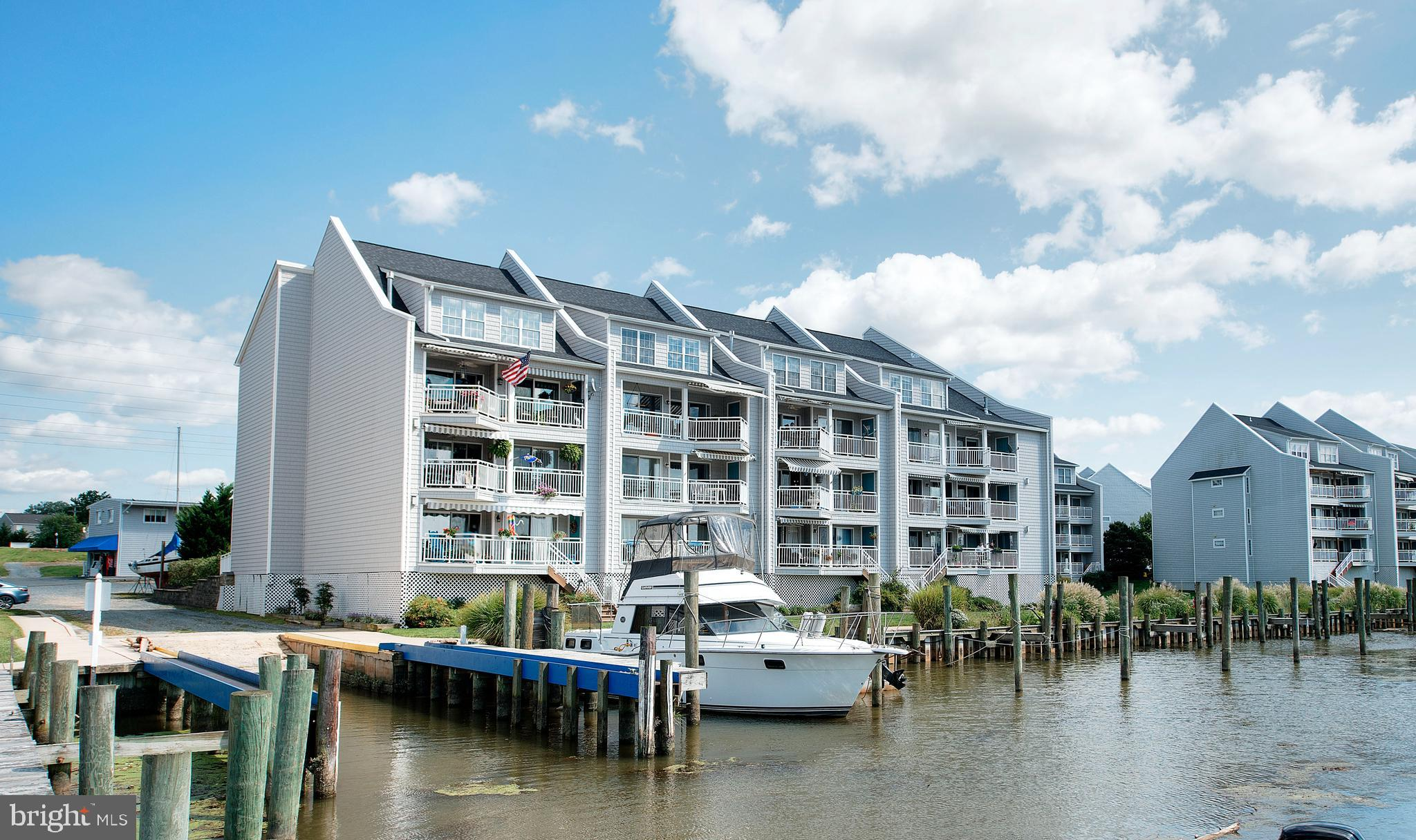 Stunning 2-story water-front penthouse featuring fresh interior paint and new carpet  on the lower l