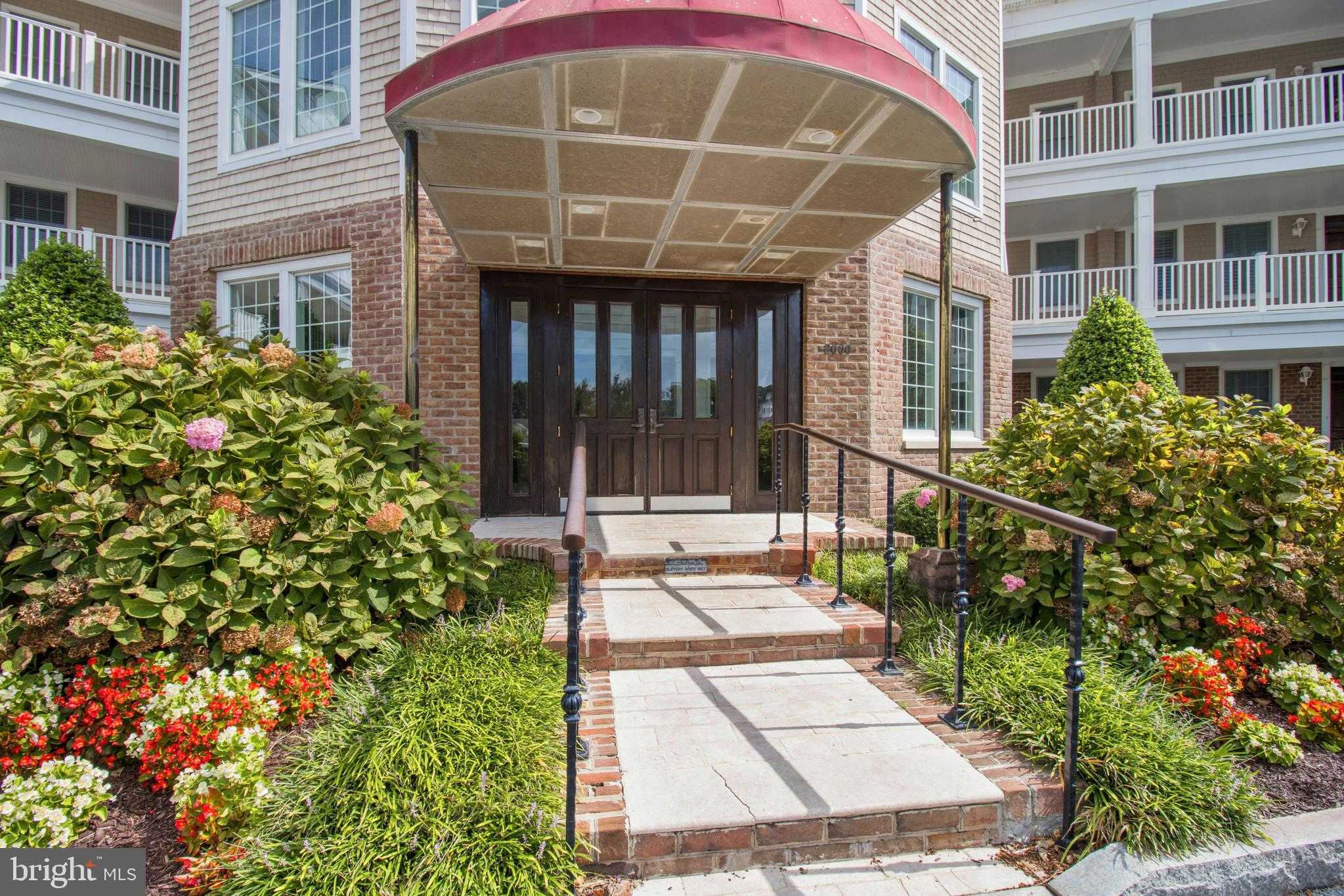 """WOW will be the first words out of your mouth when you walk into this unique """"Pivot"""" unit in  sought after Points Reach at The Point in Ocean Pines! Every detail was considered throughout this 3 bed, 3 full bath home, with an additional half bath in the hall way for guests.  Sweeping panoramic waterviews of the Ocean City skyline and Turville Creek. Italian marble flooring in the bathrooms and on each of the TWO patios.  The outside also boasts a Viking built in gas grill for your use!  Granite countertops in the kitchen and Jenn Air stove, ovens (two) and microwave. California closets in 3 master closets and 1 foyer closet.  Geothermal heating and air, as well as a gas fireplace and tinted windows.  West Coast Hollywood Infrared Sauna is just one more thing to enjoy about this home! Bike storage for owners and all the amenities that Ocean Pines has to offer!  Multiple pools, golf membership available, tennis courts, pickle ball, multiple parks, and the list goes on and on! Make an appointment to see this today.  Do NOT miss out!"""