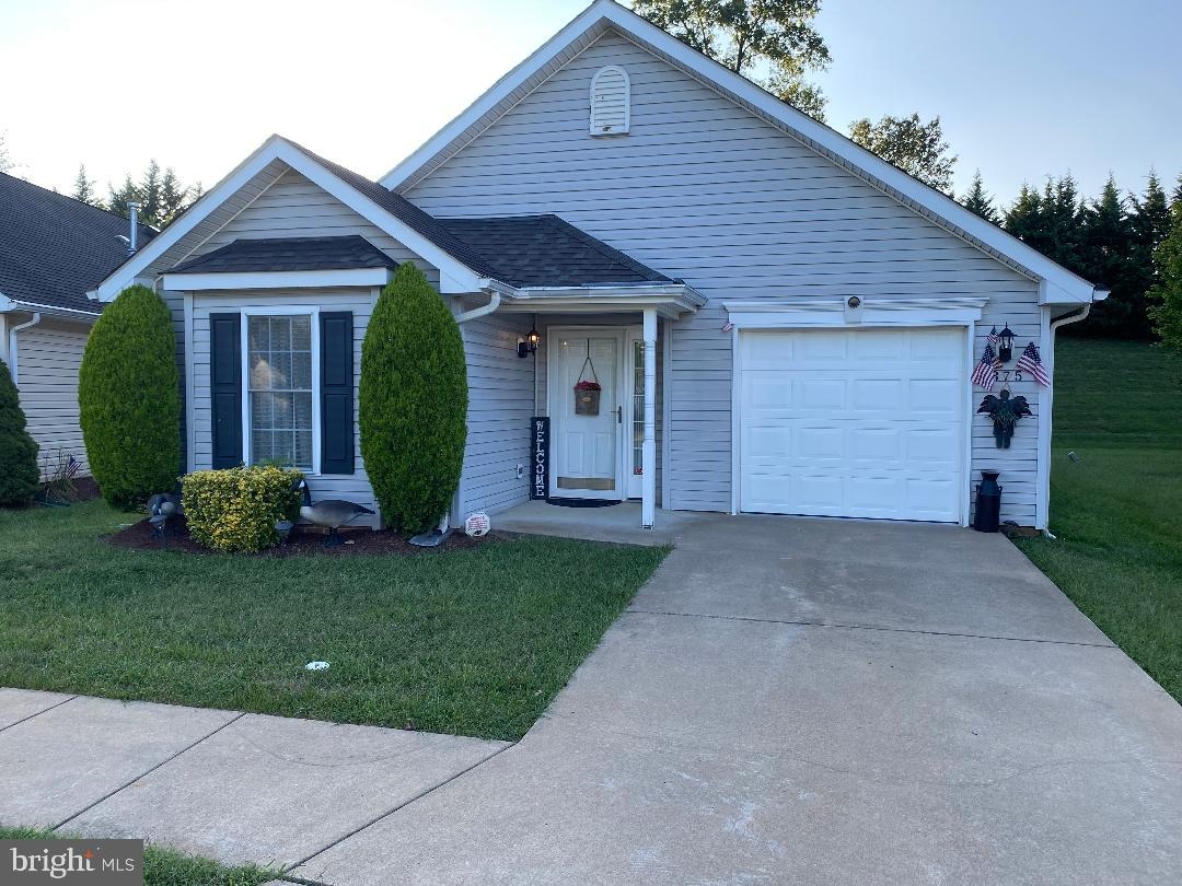 One of the top age qualified communities in Winchester.  This home is larger then the largest home originally built.  It has an extra Sun Room which looks out over a common area - Only Grass & Trees. Open floor - Carpet is only 1yr old, Appliances and hot water heater relatively ne 3 to 5yrs.  The Kitchen has additional space for an breakfast table.  The Air conditioner was replaced 3yrs ago.  The new sunroom is 8 by 13 with a perfect view.  The storage cabinets in the garage convey.  Pull down stairs to a floored attic storage area.   This home has one of the largest lots in the Willow Lawn Community.