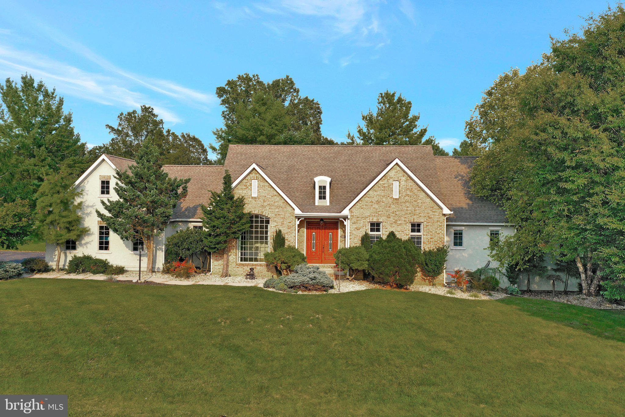 You must see this gorgeous custom built brick and stucco home with a 3 car garage on  nearly 1/2 acr
