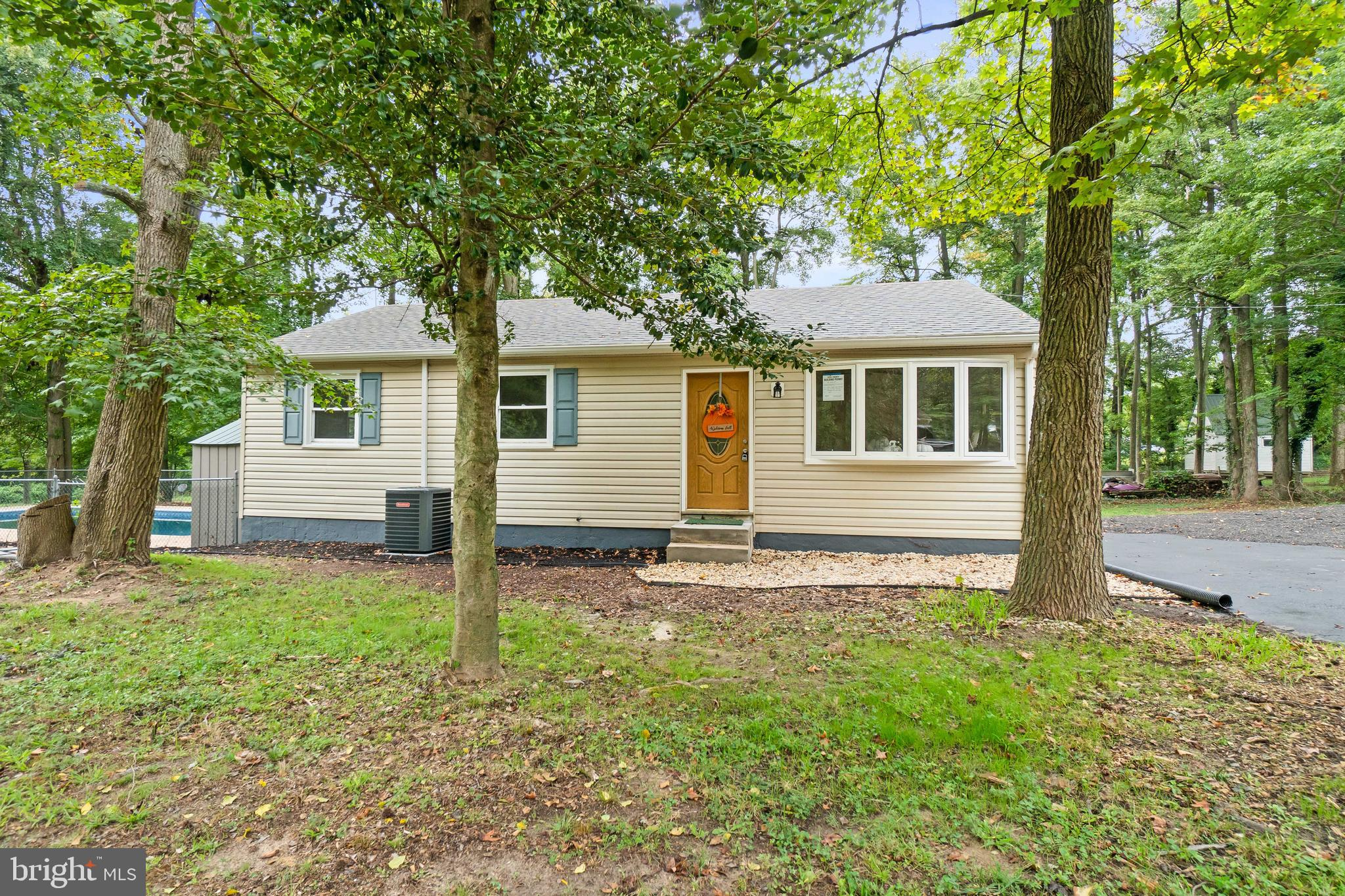 Completely renovated move-in ready rancher with in-ground pool (new liner and pump), detached 2 car