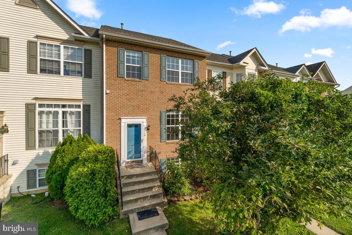 Brick front 4 bedroom 3 and 1/2 bath Townhome  in sought after Stonebridge community. This home has
