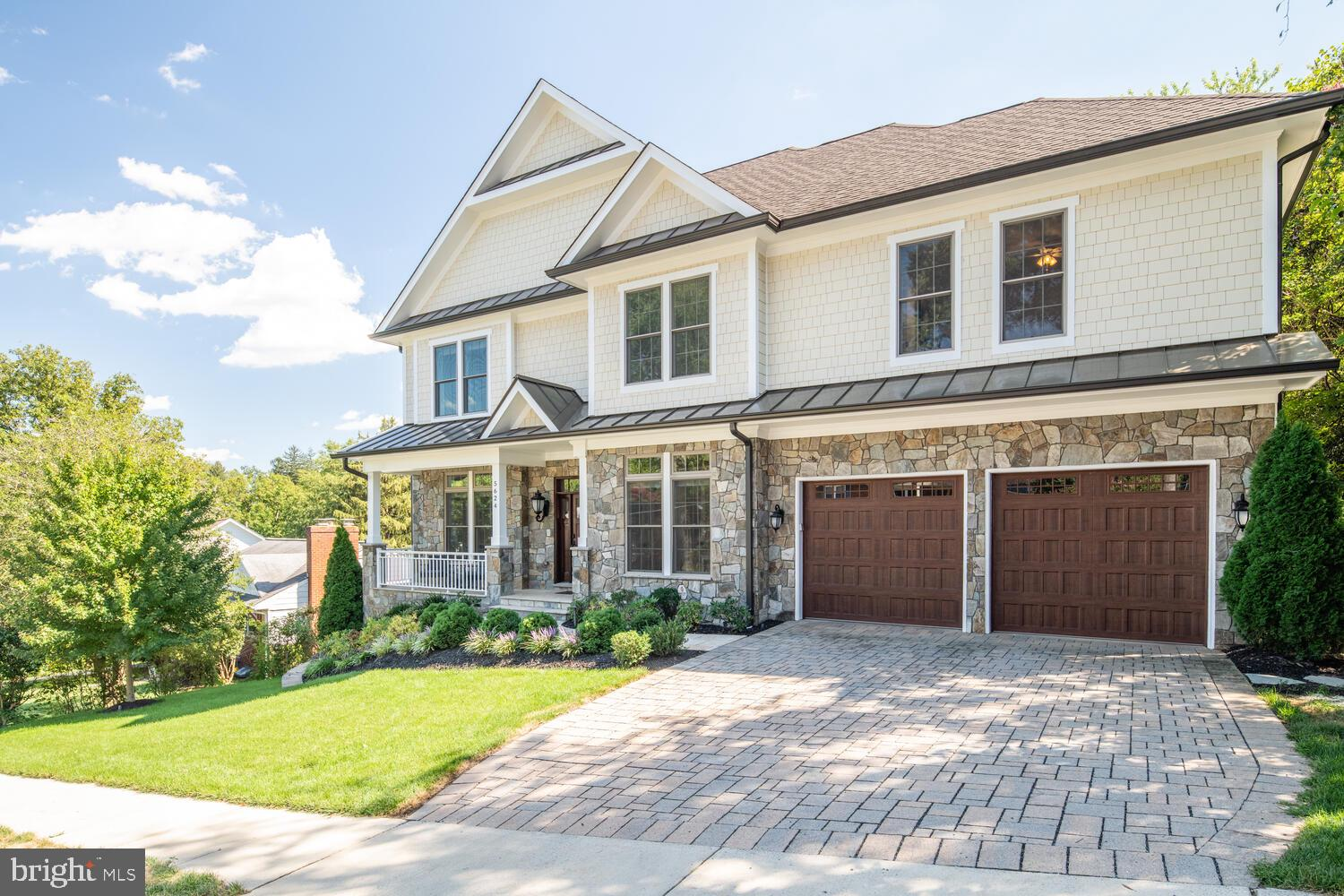 This gorgeous, updated craftsman style home built by DS Custom Homes effortlessly brings together mo