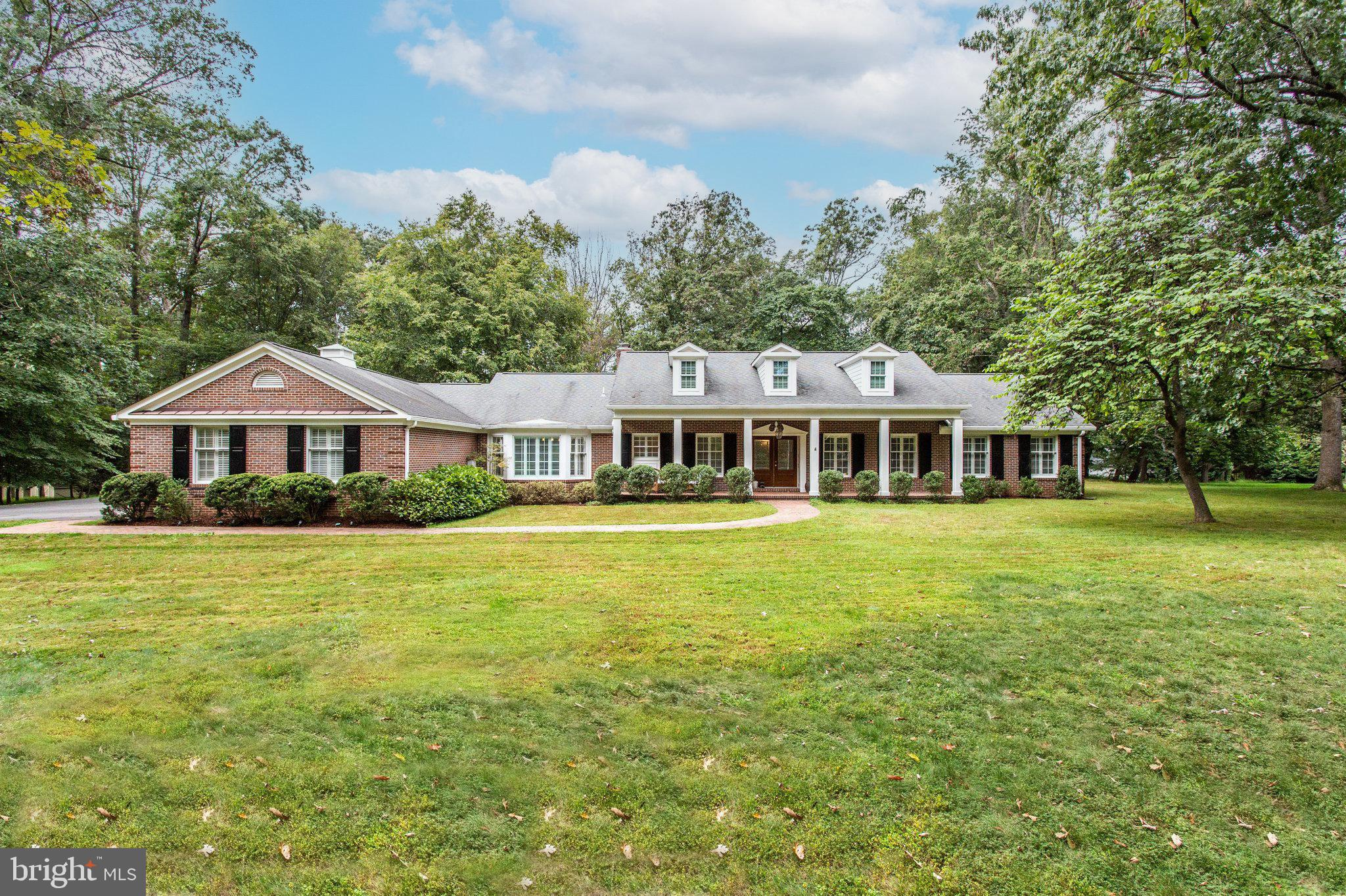 Lovely Cape Cod with two acres of scenic views, mature trees & level backyard.  The front entry prov