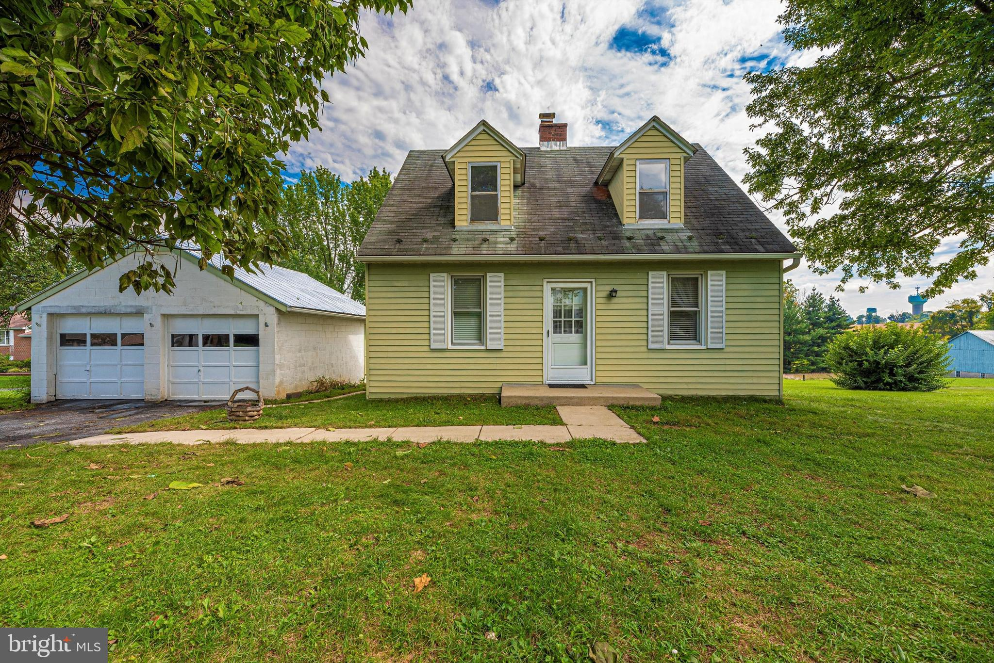 Cozy and charming Cape Cod with no city taxes on well and septic. On .8 acres with large detached 2