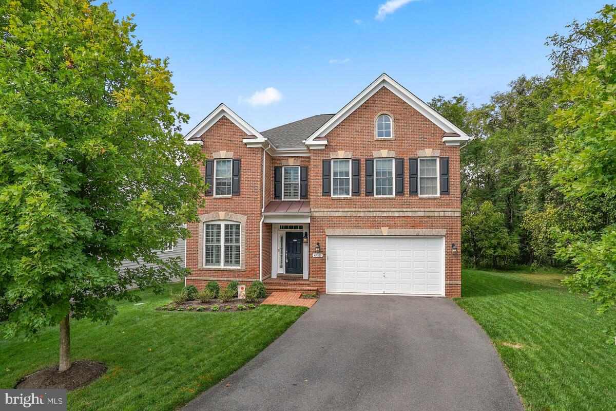 This beautiful 4,700 sq ft brick front home sits on one of the best lots in the Moreland Estates sec