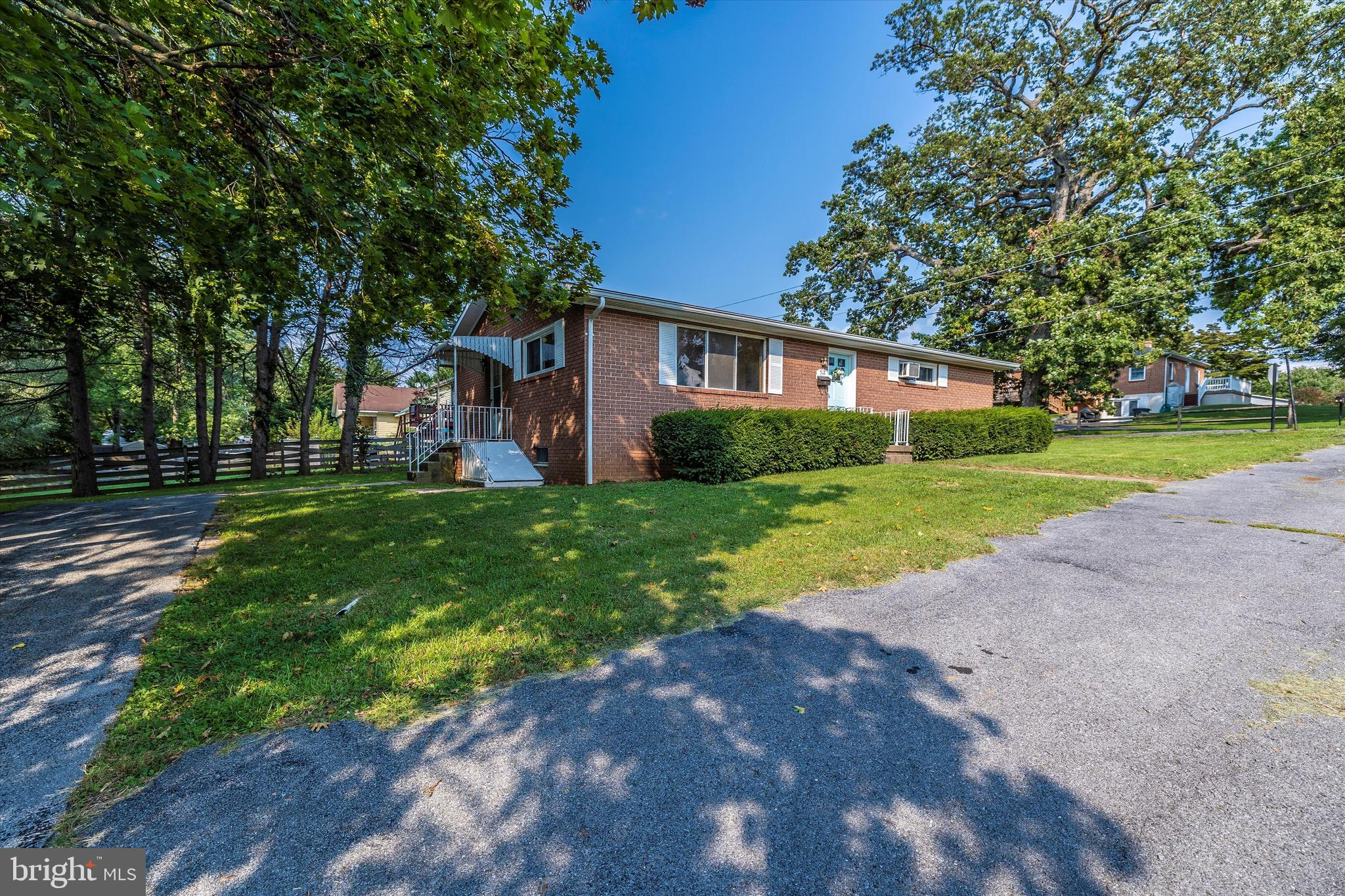 This beautiful brick rancher in Charles Town is just minutes from downtown and right across the stre