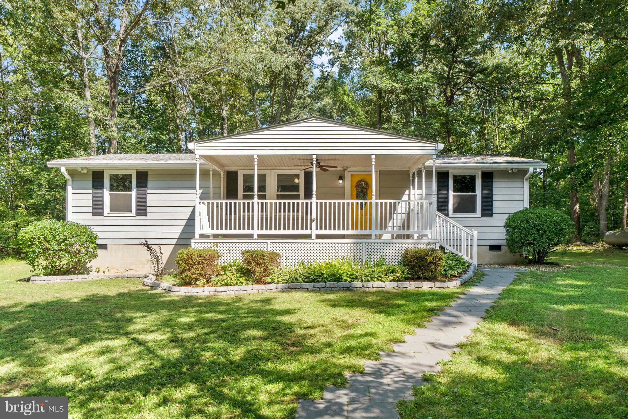 This adorable one level home is seated on just over 6 acres of land in a fantastic location! Just minutes from Route 3, Central Park, and I95. Far enough away to enjoy the quiet with a cup of coffee on the extra large front porch!