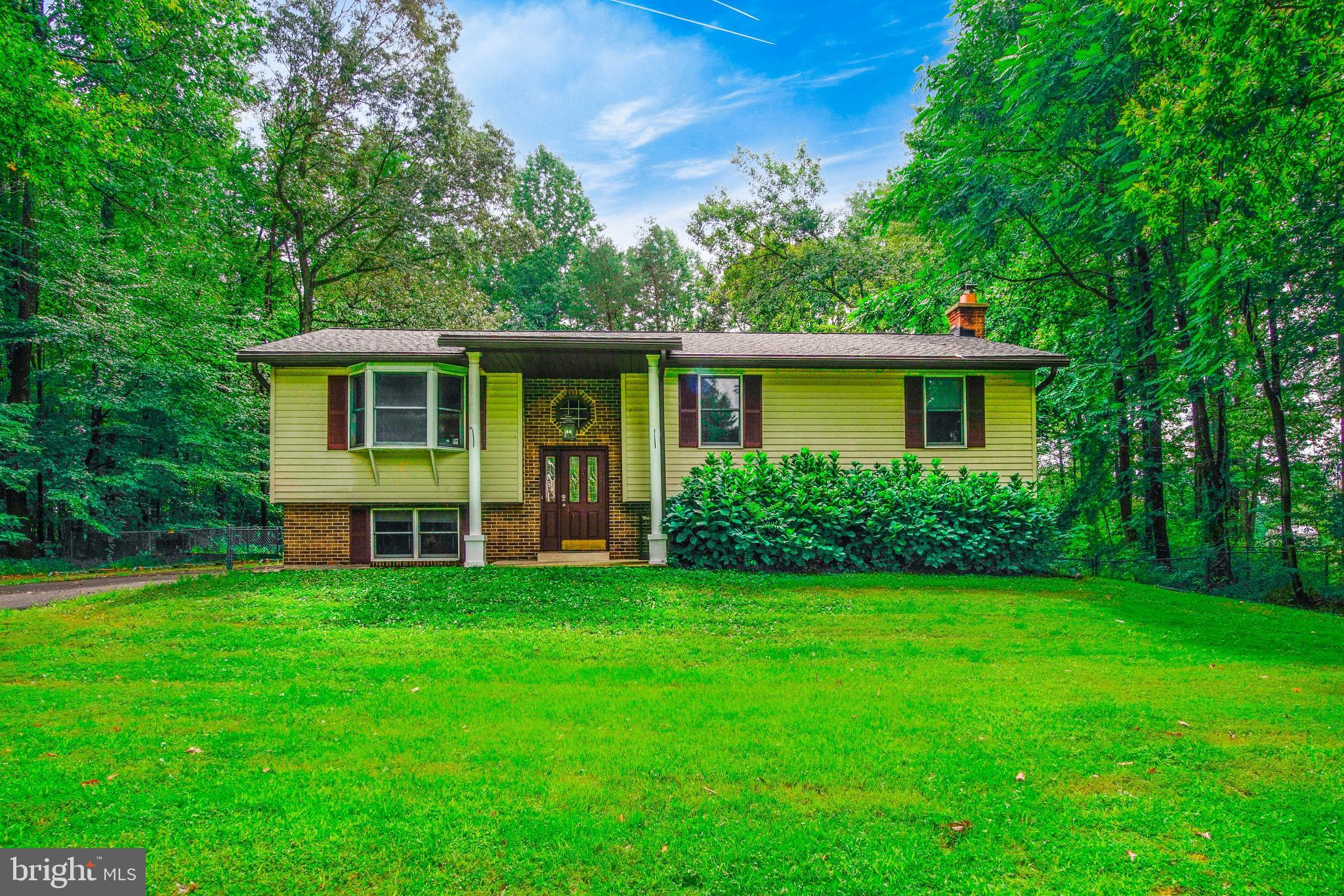 Beautifully updated 4bedroom, 3 bathroom home on a private, 1 acre lot in highly sought-after Huntin