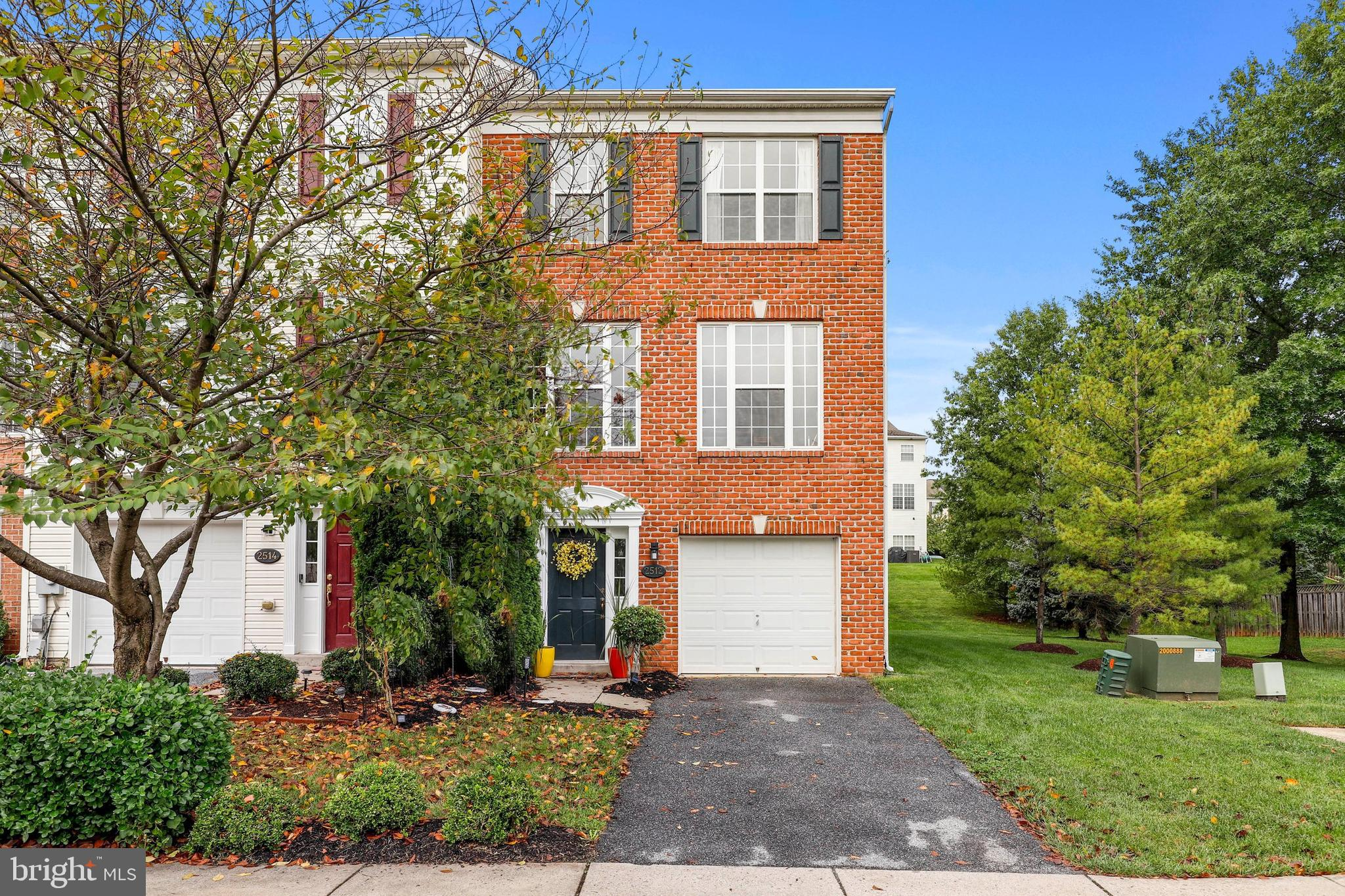 Welcome home! This brick front end unit townhouse is large, filled with natural light and so invitin