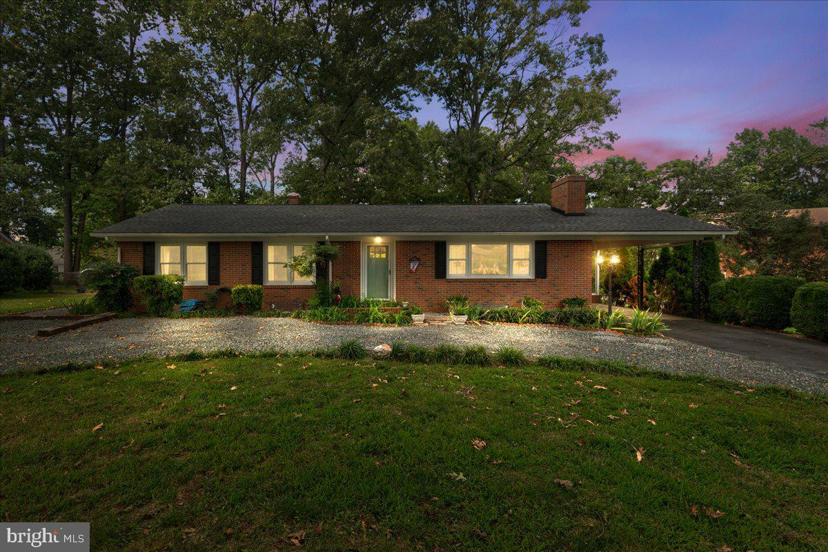 This gorgeous brick rambler got a complete makeover in 2018! Makeover to include opening up the floor plan , Newer roof, HVAC,  Windows, Updated Kitchen, 3 newer bathrooms and 1 Bedroom apartment with separate entrance in lower level! So many possibilities with this home:) Super location 5 minutes to downtown and 95. This could be a great family home with all season room and fully fenced backyard , a AIRBNB property or perfect for an extended family situation. Seller is open to selling any and or all the furniture in the home. Kitchen has upgraded stainless appliances, recessed lighting, spacious breakfast bar and opens to dining area and family room with wood burning fireplace. Beautiful hardwood throughout main level. Bathrooms have all been tastefully updated The lower level has been fully finished into a 1 bedroom apartment. Huge family room with dining space and second fireplace. There is a separate drive way and entrance to make it perfect for guests! Seller has added a few appliances to make it functional but it could easily be converted in to full working kitchen My favorite feature in this home is the All season room! This extends across the back of the home off the kitchen for extra entertaining space. To the left is a large brick patio and a big shed!! Perfect backyard to enjoy with family and friends...This one is a Gem!! Wont last long M