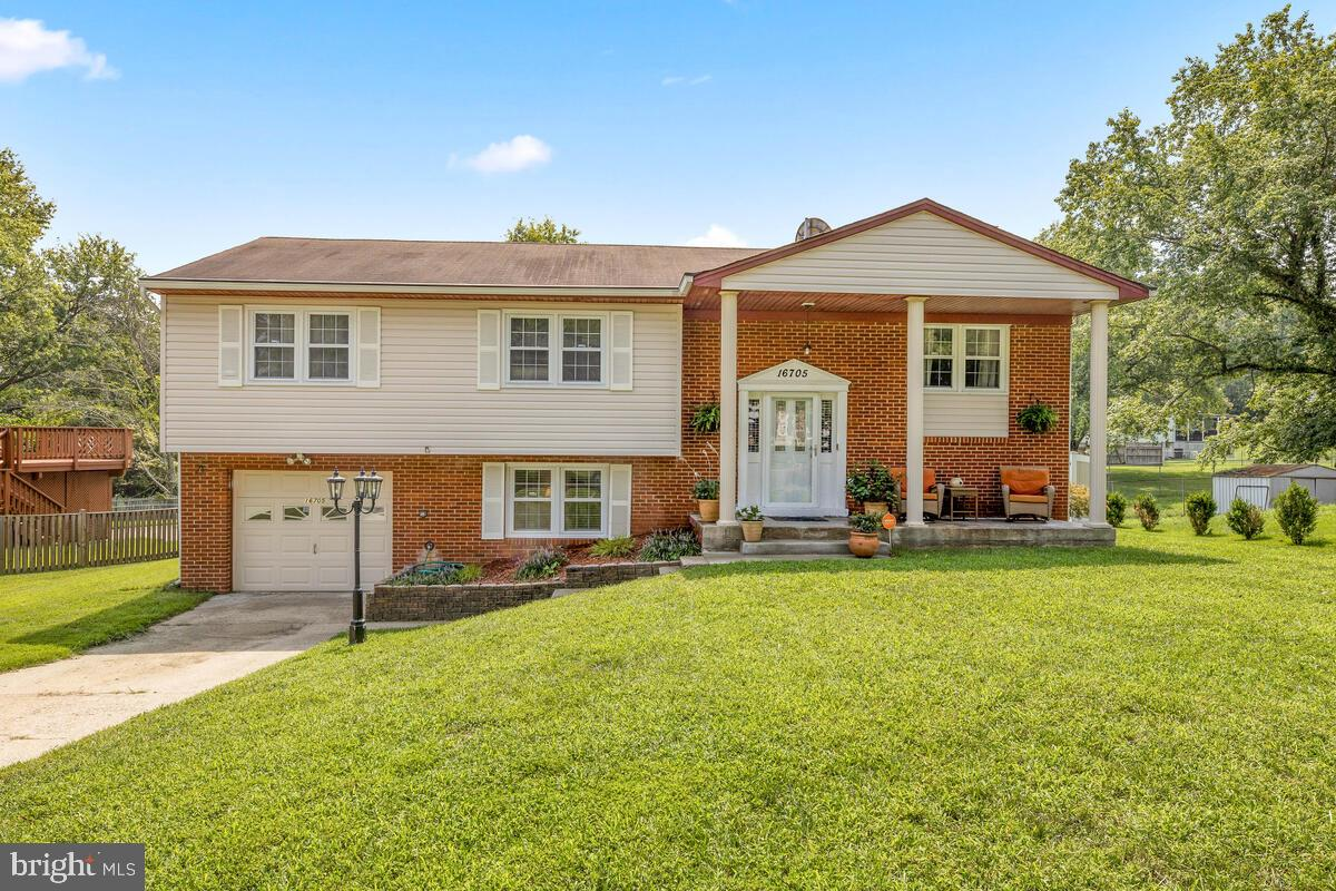You must come see this!   Beautiful well-kept single family split foyer home nestled in a relaxing c