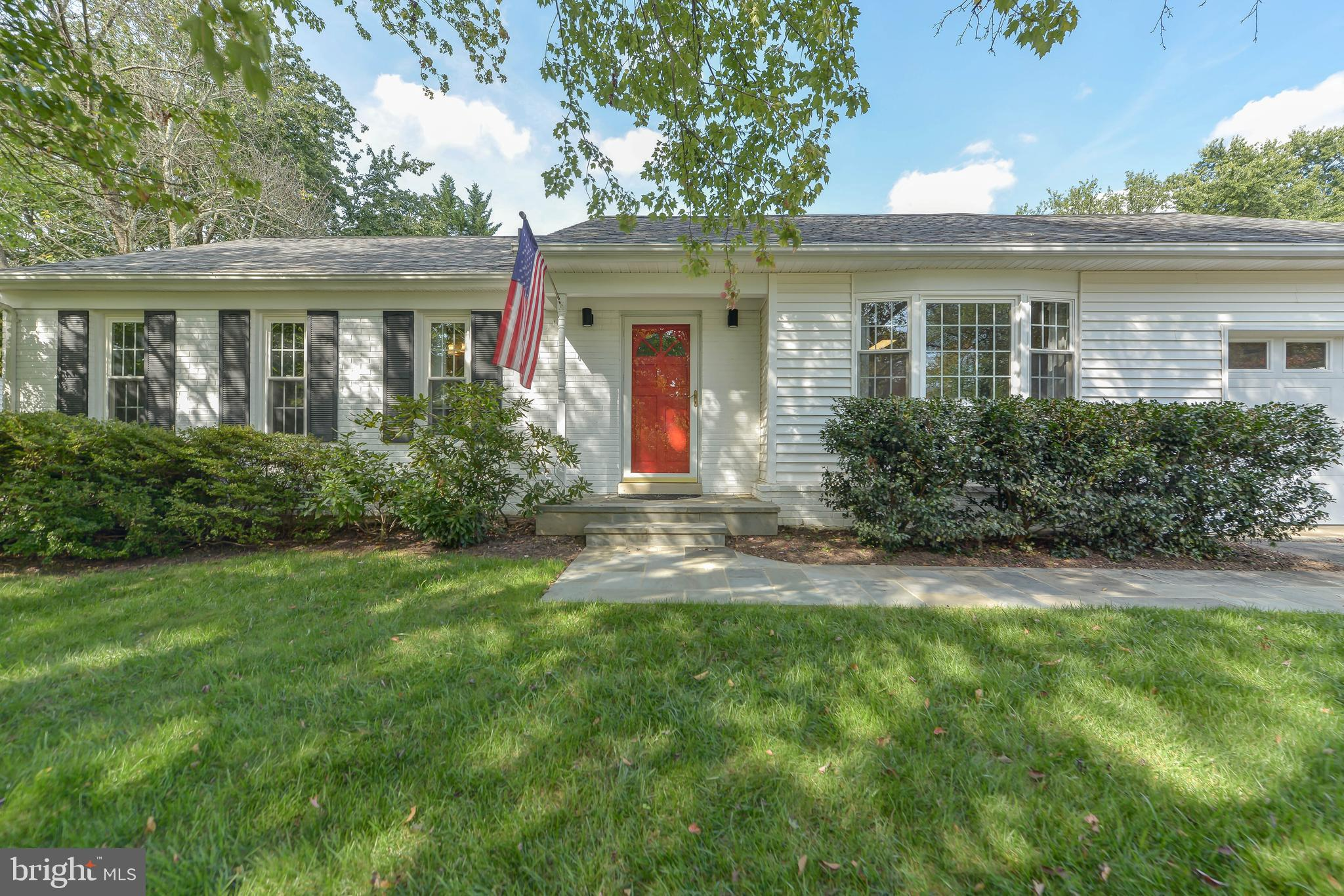 """Move right in to this welcoming, cozy & lovingly maintained rambler in well-located Manor Lake, perfect for living, playing & entertaining.  Starting from the beautiful curb appeal, throughout the updated interior, and into the gorgeous backyard oasis, this home will not disappoint!  On the entry level, enjoy the bright eat-in kitchen with stainless appliances, granite counters, large pantry and direct access to the oversized one-car garage; open living / dining area with updated flooring and windows overlooking the backyard; 3 comfortable bedrooms and 2 full bathrooms.  On the lower level, spread out in the extremely spacious family / rec room with wood stove, and sliding glass doors to the screened in porch; 4th bedroom / office; bonus room (great for a play space, music room or storage); half bathroom; and large laundry/storage/utility room.  In the fully landscaped, fenced-in and enormous backyard, you'll find an amazingly sun-filled """"shed"""" with electric service (use it as a gym, art studio or greenhouse? it's too nice for just storage!), koi pond, beautiful trees, plants & blueberry bushes, patio, basketball area and play equipment.  Updates include roof (2019), main level flooring (2019), light fixtures (2021), double-pane windows, kitchen & baths.  Close to downtown Rockville and steps to Lake Frank and Rock Creek Regional Park, this is truly a unique and beautiful home!"""