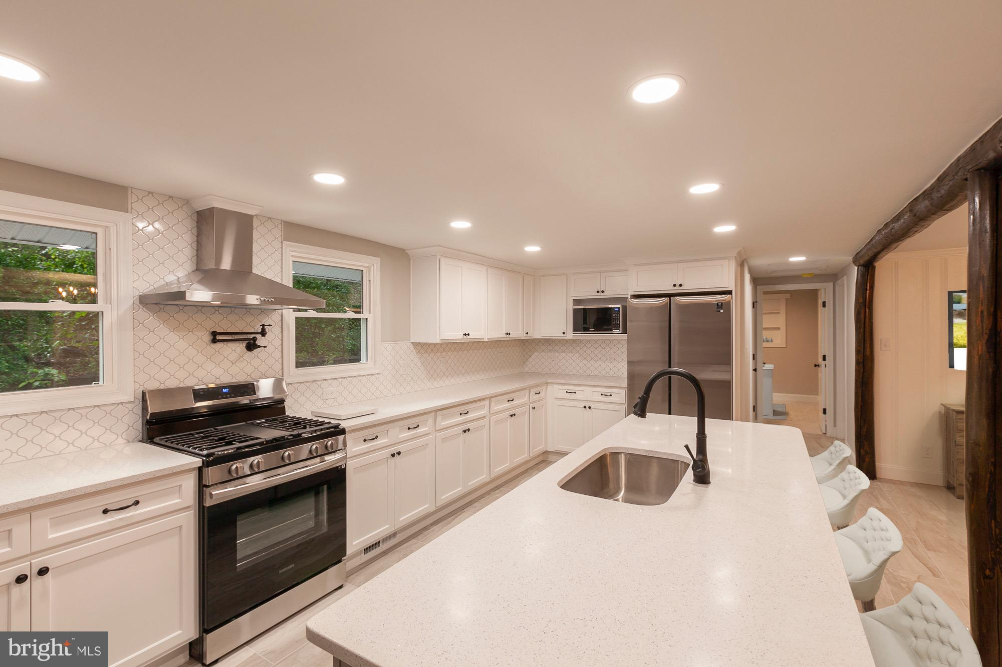 Completely renovated home that sits on just under 1 acre of land with no HOA.  Kitchen has brand new