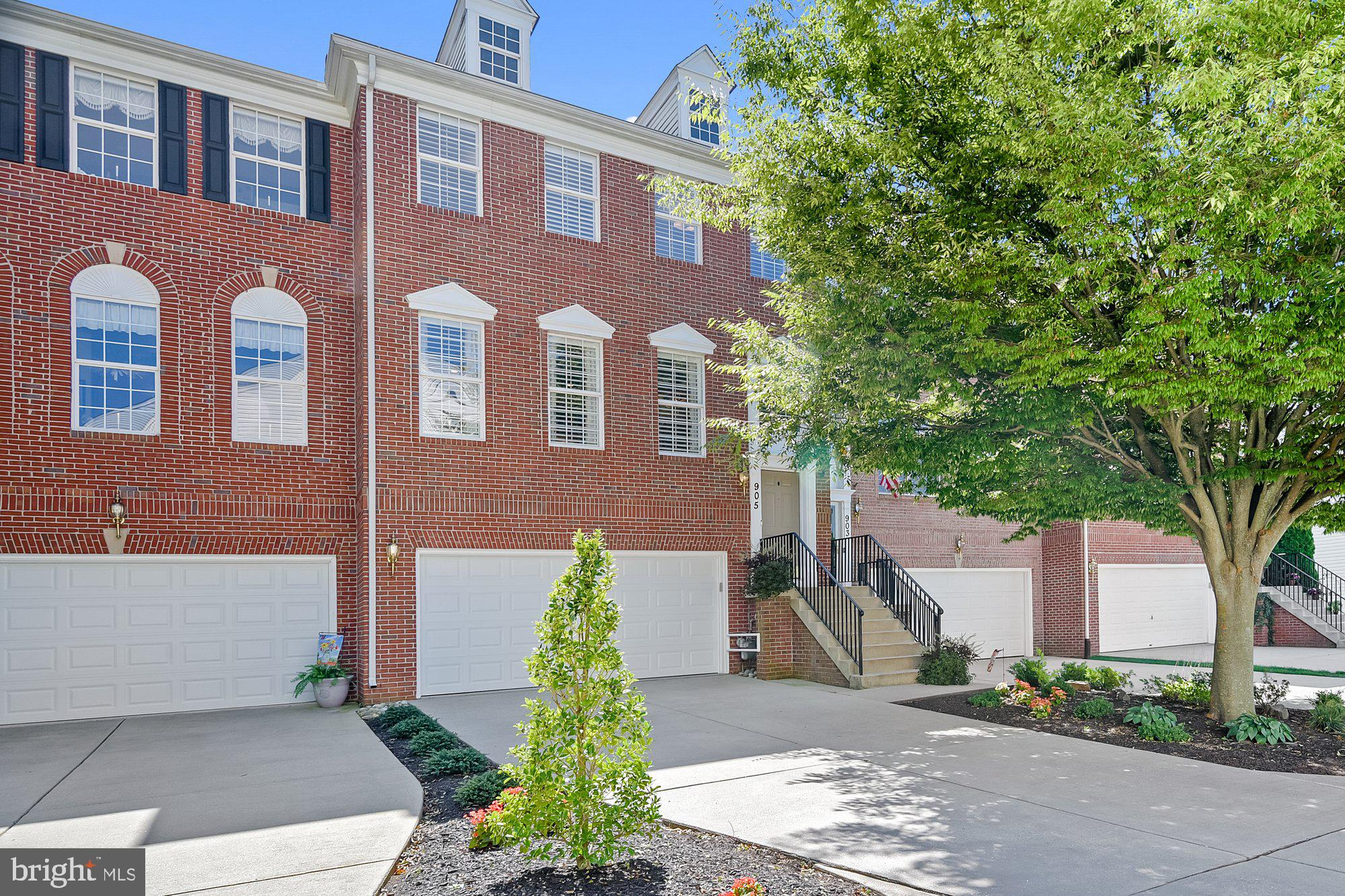 Welcome home! Three story brick front beauty offers expansive rooms bursting with natural light. The