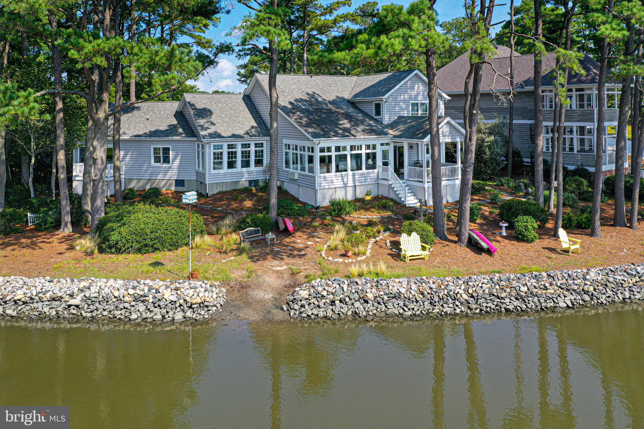 STUNNING WATER VIEWS that will take your BREATH AWAY! Enjoy the private rear yard which offers a tranquil setting with 168'of beautiful water frontage overlooking the Bay, Turville Creek and the Ocean City Skyline. This is one of the best views in Ocean Pines! Desirable cul de sac location with a large backyard where you can enjoy kayaking, water sports and wildlife. There is a covered deck where you can relax with your morning coffee as you watch the beautiful sunrise, and in the evenings you will love the colorful skies as the sun is setting and the lights of Ocean City reflect in the water.  Quality construction, owned by original owners. Builders personal residence which offers a bright open floorplan with lots of natural sunlight and a southern exposure. As you approach the home, you will notice a n elegant paver driveway and oversized (24x30) garage. Brick front steps lead you to a covered front porch. As you enter the home, you'll see the panoramic water views and a spacious great room with a unique custom wood ceiling. There are 2 sunrooms, which are great for entertaining. There is a spacious first floor primary suite which offers a private balcony, sitting/ tv area and a large bath. Upstairs features 2 bedrooms, full bath and a large multi purpose room over the garage which would make a great office or game room.  All the bedrooms have access to a bathroom. Geothermal HVAC system offers low electric bills. This floorplan was designed to take advantage of the water views, with no wasted space. There are many additional features including nice trim detailing and ample storage including 2 floored attics with pull down stairs.  Schedule your appointment today!