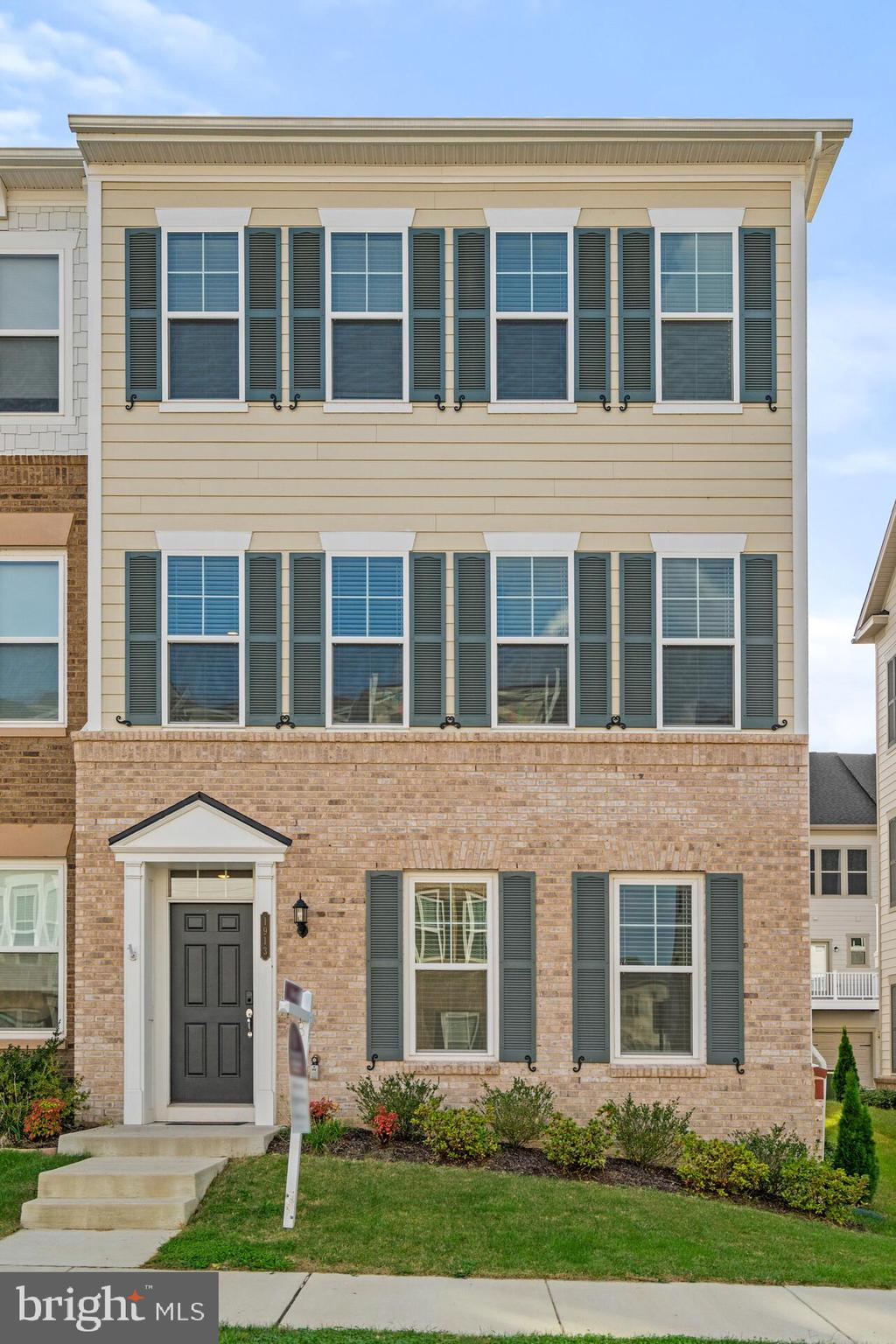 SPACIOUS & INVITING, 4 BED/3.5 BATH, 2 CAR GARAGE END UNIT crafted by Pulte Homes!  CONVENIENTLY LOCATED near the Entrance Gate, Fairway, and Clubhouse.  This home is in one of the recently completed townhome sections, so NO CONSTRUCTION NOISE.  HARDWOOD on ENTIRE MAIN LEVEL!  HUGE Gourmet Kitchen and Dining Area, Stainless WI-FI ENABLED APPLIANCES including Gas Cooktop, Hood Vent, French Door Frig w/Ice Maker, Dishwasher, Built in Convection Microwave & Oven; Walk in Pantry & Island that extends for days!!  EAT, DRINK, COOK, WORK, RELAX, ENTERTAIN.......whatever you need to do, there is MORE THAN ENOUGH SPACE to do it!  Need hobby/rec/activity rooms?  Have kids, pets, overnight guests, or extended visits??......Choose from one of the LARGE SECONDARY BEDROOMS on the Upper Level or the PRIVATE SUITE on the Lower Level.   Whatever your day brings, escape it all in the LUXURY OWNER'S RETREAT and lock the door behind you!  PLENTY OF ROOM for a King Size Bed, lots of natural light, and the OWNER'S BATH is just a few steps away; including DESIGNER TILE PLANK FLOORING, Shower w/top to bottom Subway Tile & Mosaic Shower Pan, Dual Towel Bars,  DOUBLE SINKS w/UPGRADED VANITIES & Natural Stone Vanity Top, Separate Water Closet, & W.I.C. for clothes, shoes, and/or storage with  built in wire shelving!  On the exterior enjoy a Partial BRICK FRONT, and to the rear a LOW to NO MAINTENANCE COMPOSITE DECK and private driveway from the residents access road.  Why wait for new construction and deal with delivery delays, subbing your selections, inventory/manufacturing shortages, hefty price increases, and overall uncertainty??  This home is LESS THAN 2 years old and LIKE NEW!  Owner is military and transferring to the West Coast or this would have been a home for the ages!  If you're not familiar with the area, please Google Potomac Shores & Stonebridge Town Center.  Award Winning Golf Course, VRE, Exclusive Schools, Upscale Shops & Dining all nearby.  Enjoy the Northern VA feel but w