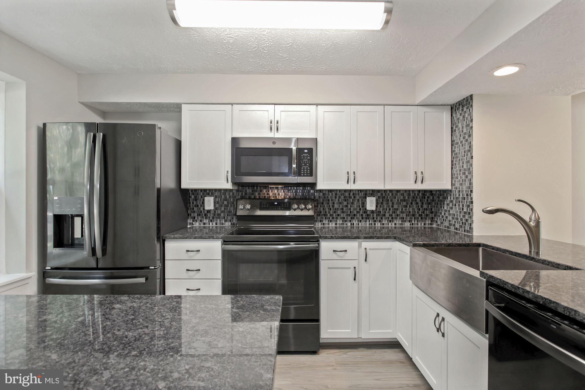 End-unit townhouse in Newington Commons. 3 level 2-bedroom home with walkout basement.  All new floo
