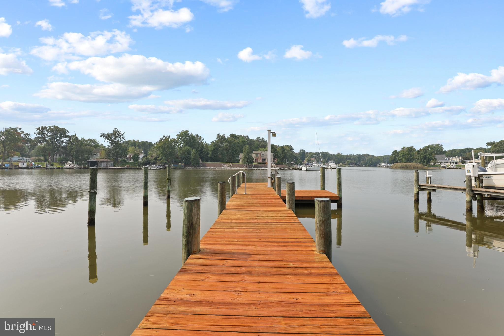Now is your chance to own a superior waterfront property located on Wharf Creek.  This is a double lot with approximately 50 feet of waterfront frontage that is a quick boat ride to get to the Chesapeake Bay. Envision yourself enjoying a warm drink in the morning as the sun rises over the glistening waters surrounding your private pier.  The private pier is equipped with water and electricity all the way to the end of the pier! Park your boat and invite a fellow boater to park their boat in either of the two available boat slips.  With an MLW of 6 feet, you can keep your boat close to home and ready to launch at a moment's notice.   Enjoy a dip in the water off the side of the platform which is ideal for sunbathing, fishing, crabbing, or enjoying the cool breeze from the Bay winds. The boathouse features a water heater for a relaxing outdoor shower experience. The property includes a boathouse and a bungalow.  The home has been prepared to be razed to build a larger home.  Additionally, Anne Arundel County has approved a site plan for a larger home which includes approval for an upgraded septic system.  The surrounding community offers two local parks that overlook the Bayfront. A voluntary community association offers access to the community boat ramp for only $25 a year! Book your appointment today for your chance to own a rarely available lot located within the Chesapeake Watershed!