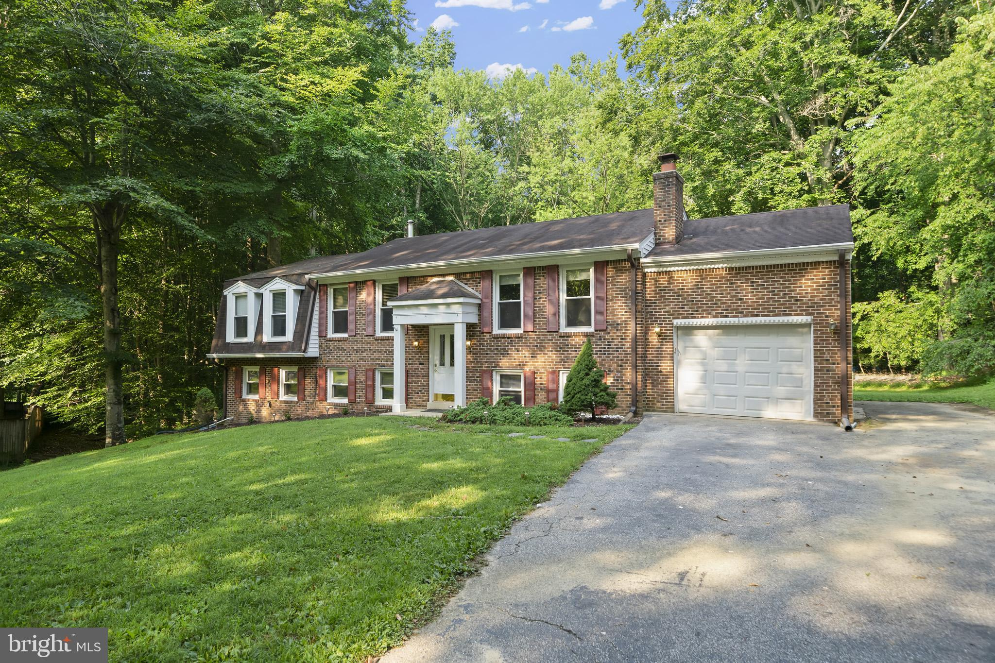 Location Location Location!!! Plenty of room to spread out in this spacious brick front beauty. Upst