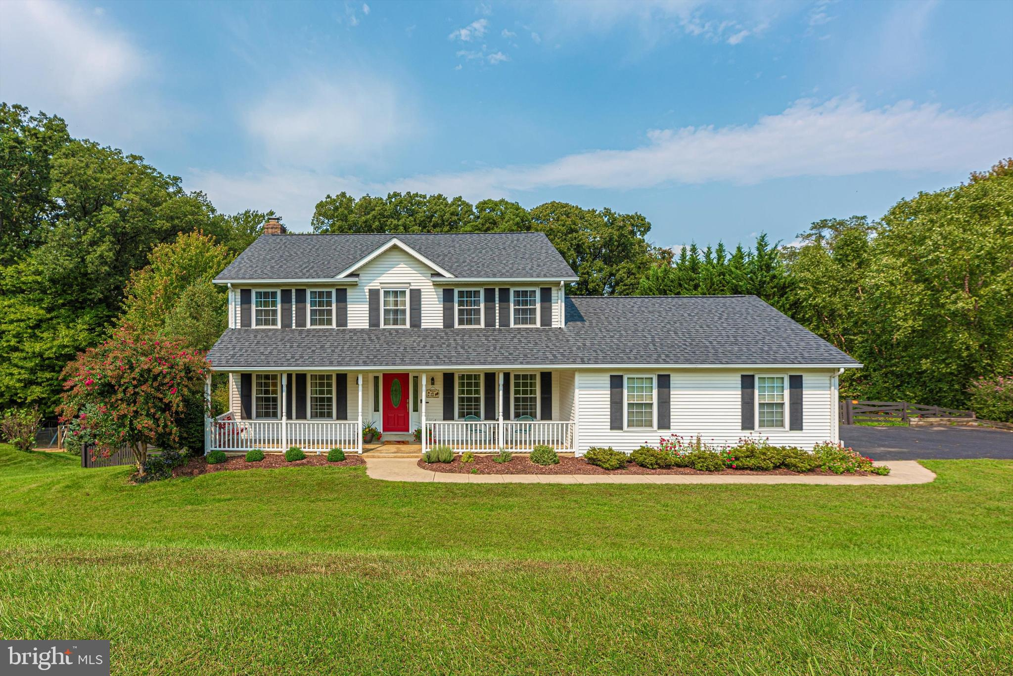 This Charming and Private Beautifully Updated Colonial situated on almost an Acre in sought after Br