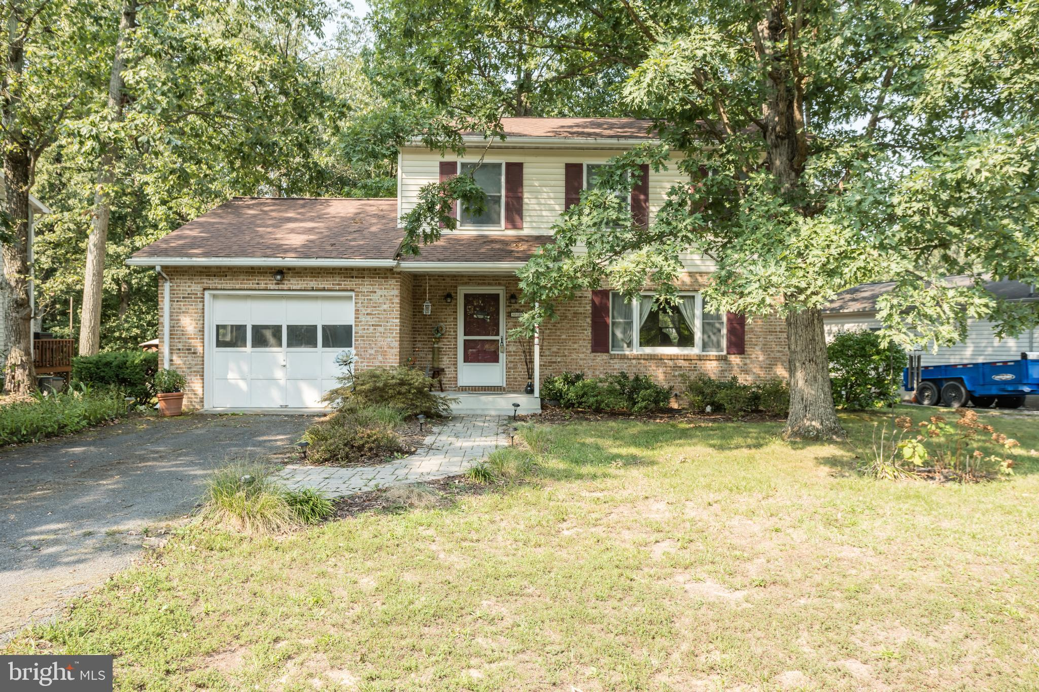 Adorable updated colonial with Central Heat and Air, Newer kitchen with quartz counters, cherry cabi