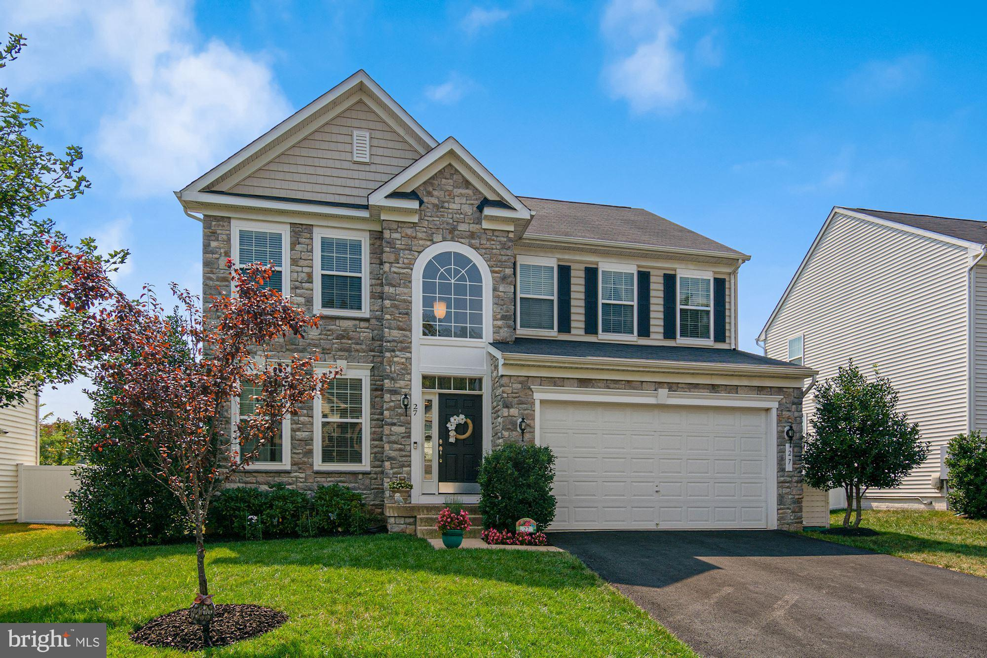 Gorgeous, well-appointed home with a fantastic floorplan and spacious rooms; located on a short cul-