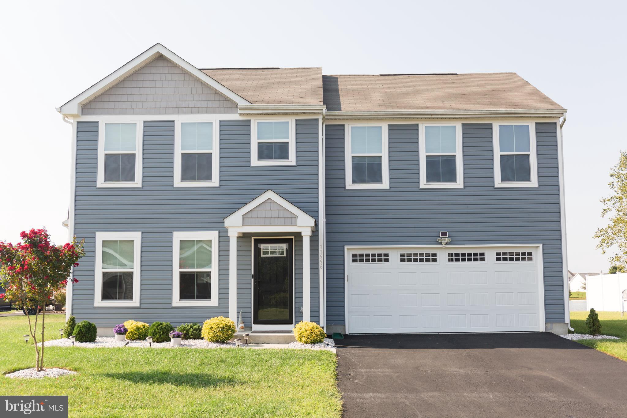 Beautiful two story home nestled on a premium corner waterfront  lot with gorgeous pond views.  Why
