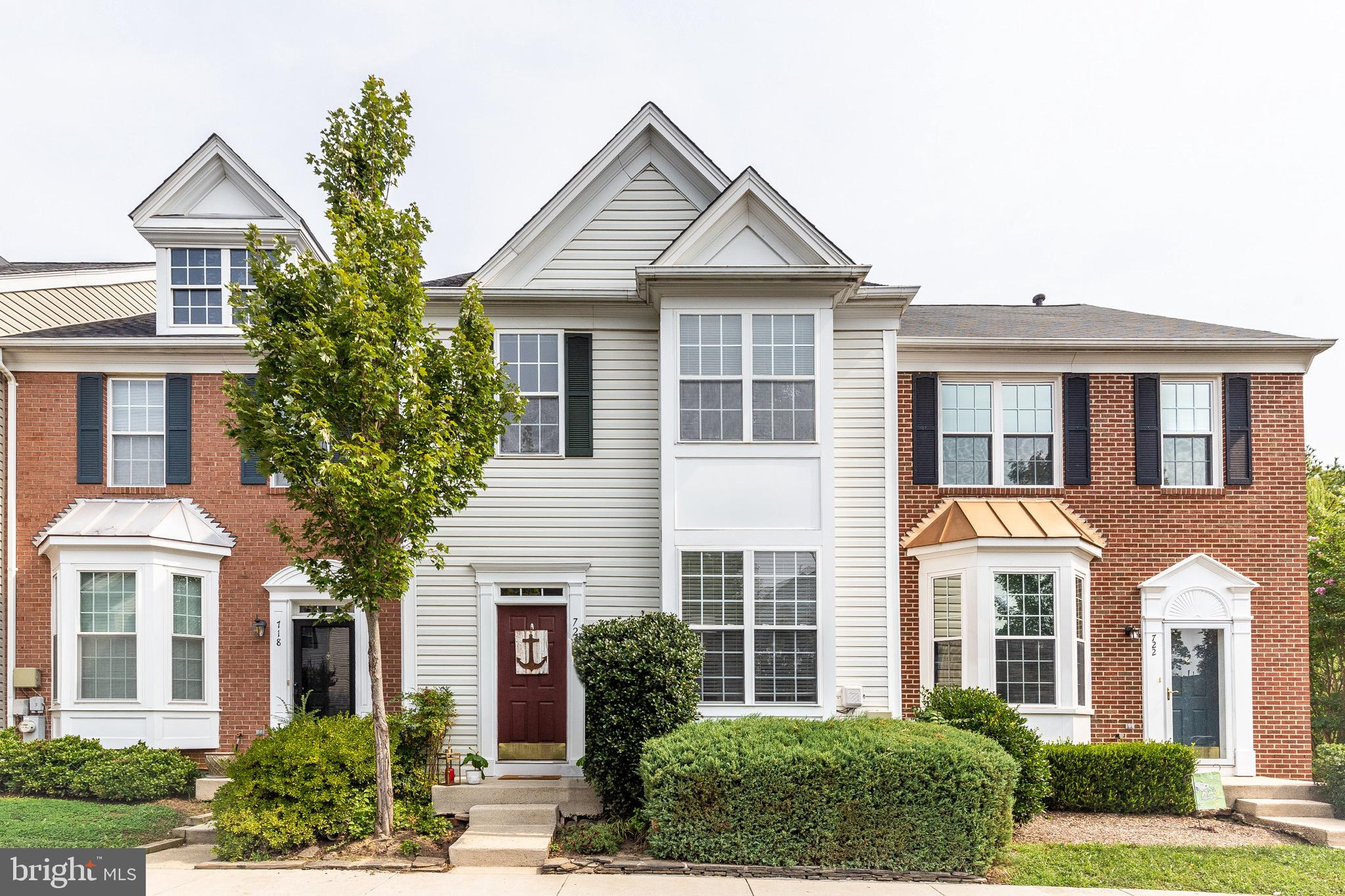 Great Location & Opportunity!  3-Level Fully Finished Townhome with desired Fenced-in Yard & easy access to RT 50/ 97.  This home features tons of natural light, easy maintenance, and a Lock & Leave lifestyle. Super convenient to Downtown Annapolis & Naval Academy Stadium.  New  Roof 2018!  Living Room features wall-to-wall carpet, eat-in kitchen, island with cabinet storage, ceiling fan, half bath & large deck (Painted 2021).  The Upper Level includes the Primary Bedroom with ceiling fan, vaulted ceiling, modern white/grey large tiled bathroom that was recently remodeled, and two additional bedrooms and another full bath. Fully finished lower level with private entrance to outdoor patio, recreation/ entertainment room featuring wall-to-wall carpet, Natural Gas Fireplace w/ pretty surround, half bath, laundry room & storage area. Additional community green space,  walk-paths, tot lots & playgrounds.