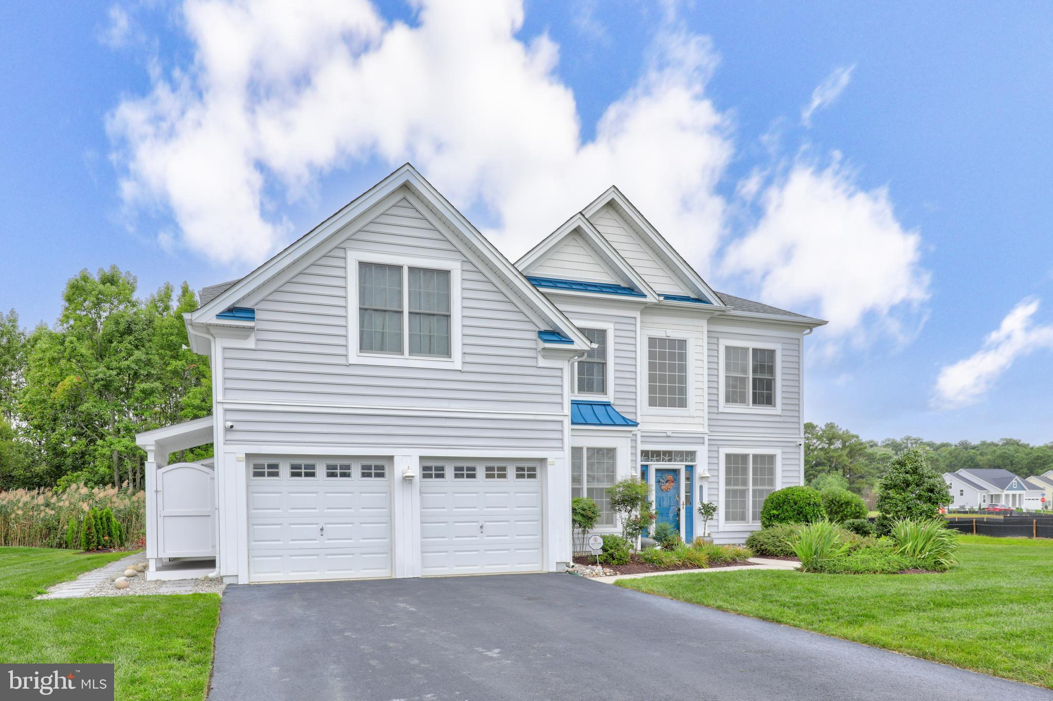 Impressive 4 bedroom, 3 1/2 bath home featuring the perfect combination of elegance and coastal  sty