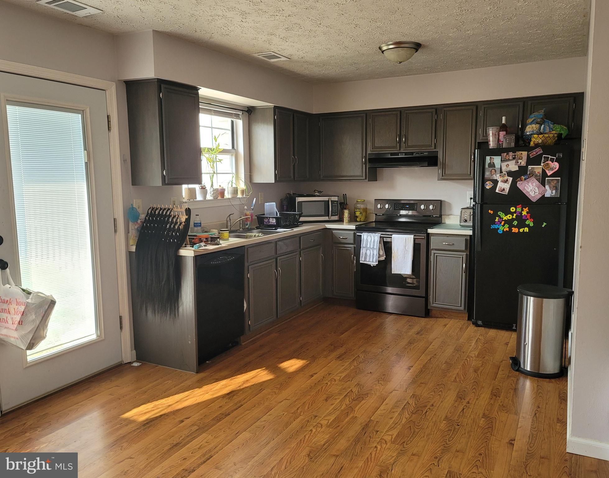 LOVELY 3 bedroom, 1.5 bath townhouse with fenced back yard includes upgraded bathrooms, kitchen floo