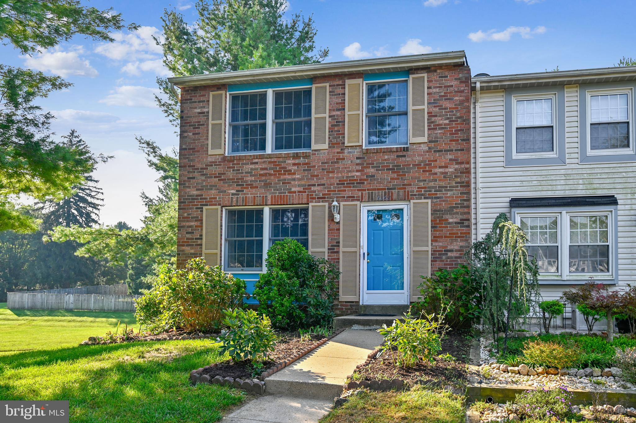 Welcome to this End of Group brick front townhome located on a cul-de-sac with wooded views.  With h