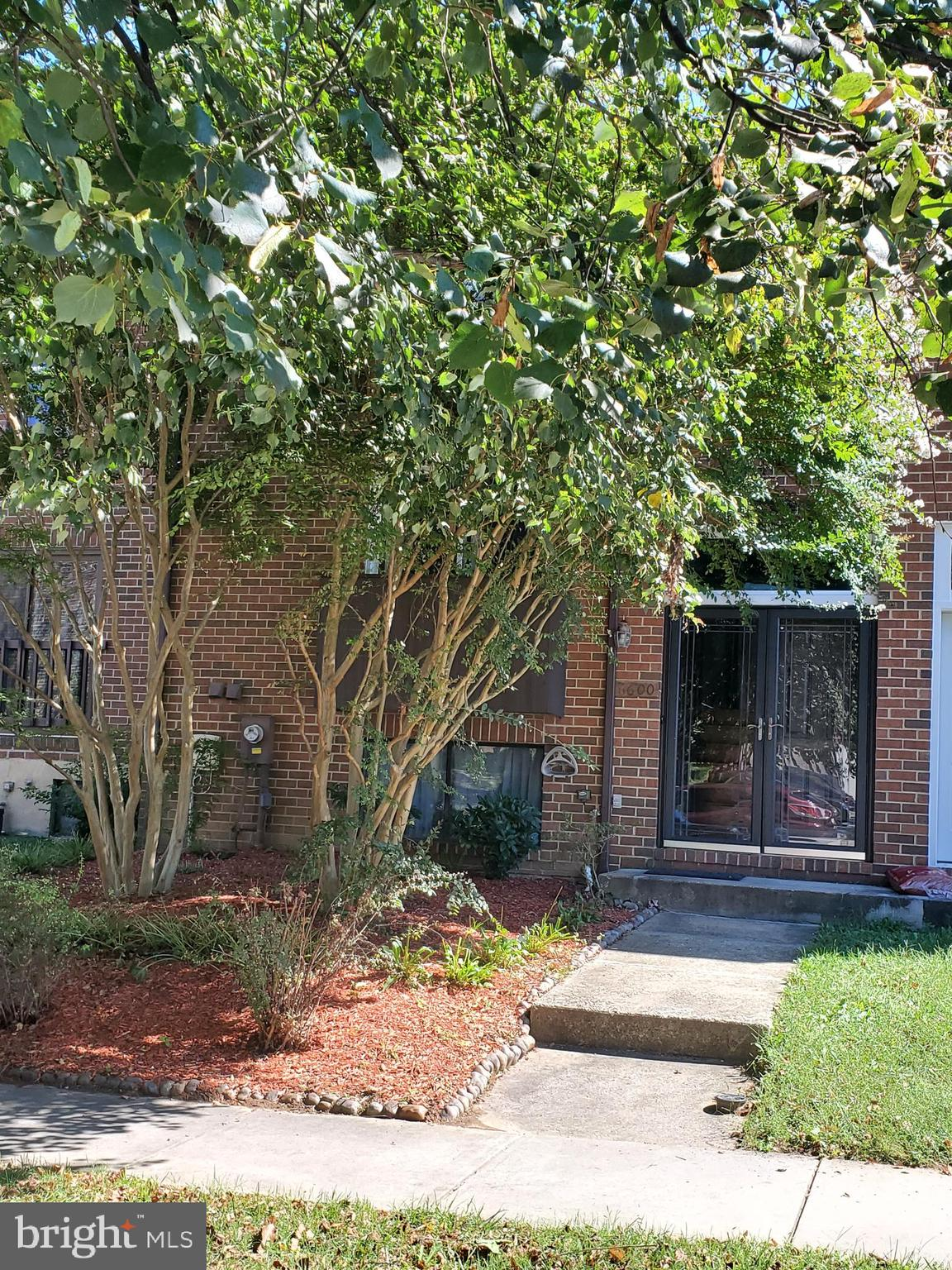 Beautiful brick townhouse located in the Village of Owen Brown and within walking distance to Elkhor