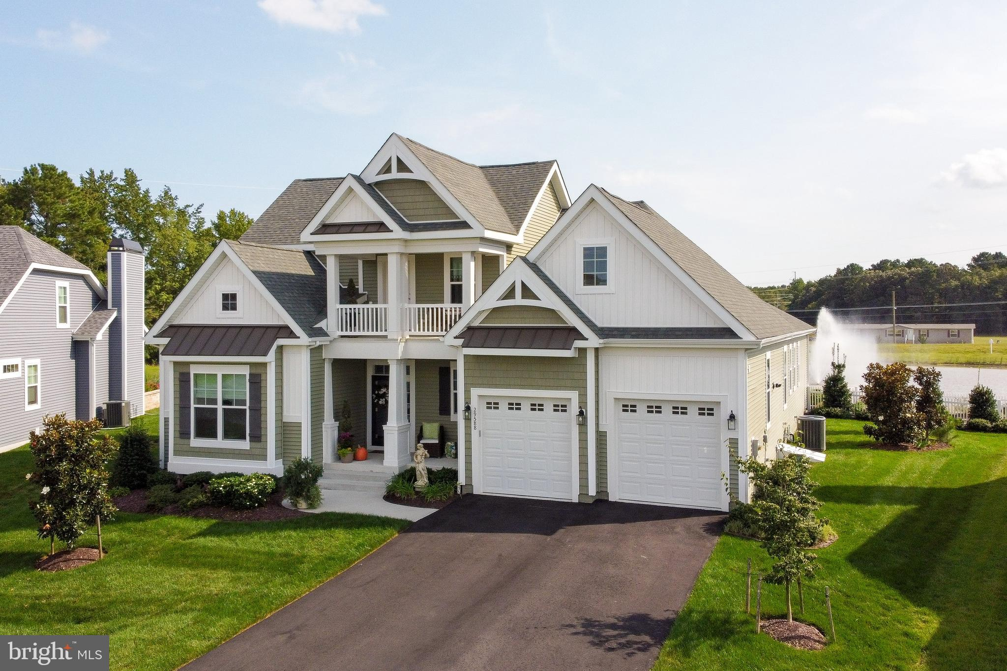 CAREFREE LIVING awaits you in this gorgeous, pond front 3 bedroom, 3.5 bath home in the amenity-rich
