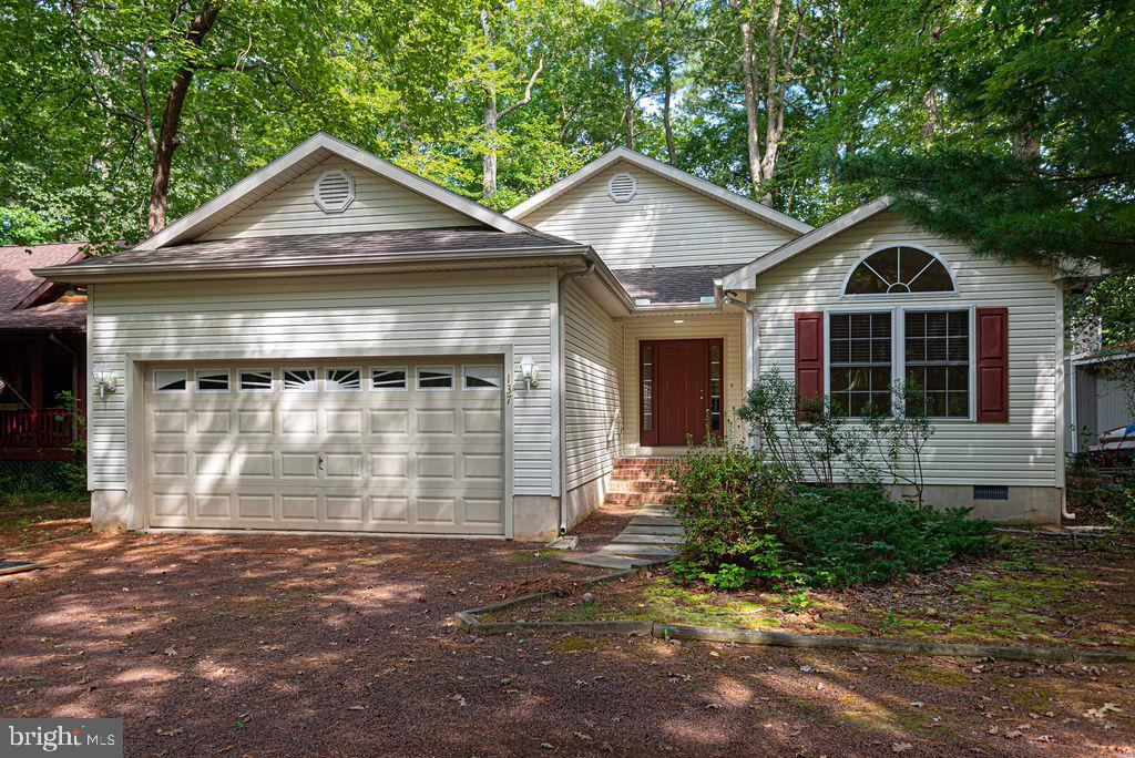 Outstanding Golf Corse Home Constructed By Piney Island With Great View Of Golf Course. Home Has Sunroom ,Screened Porch, 2 Car Garage, Large Deck, Fireplace, All Appliances, Ceiling Fans. Home Being Sold AS IS.