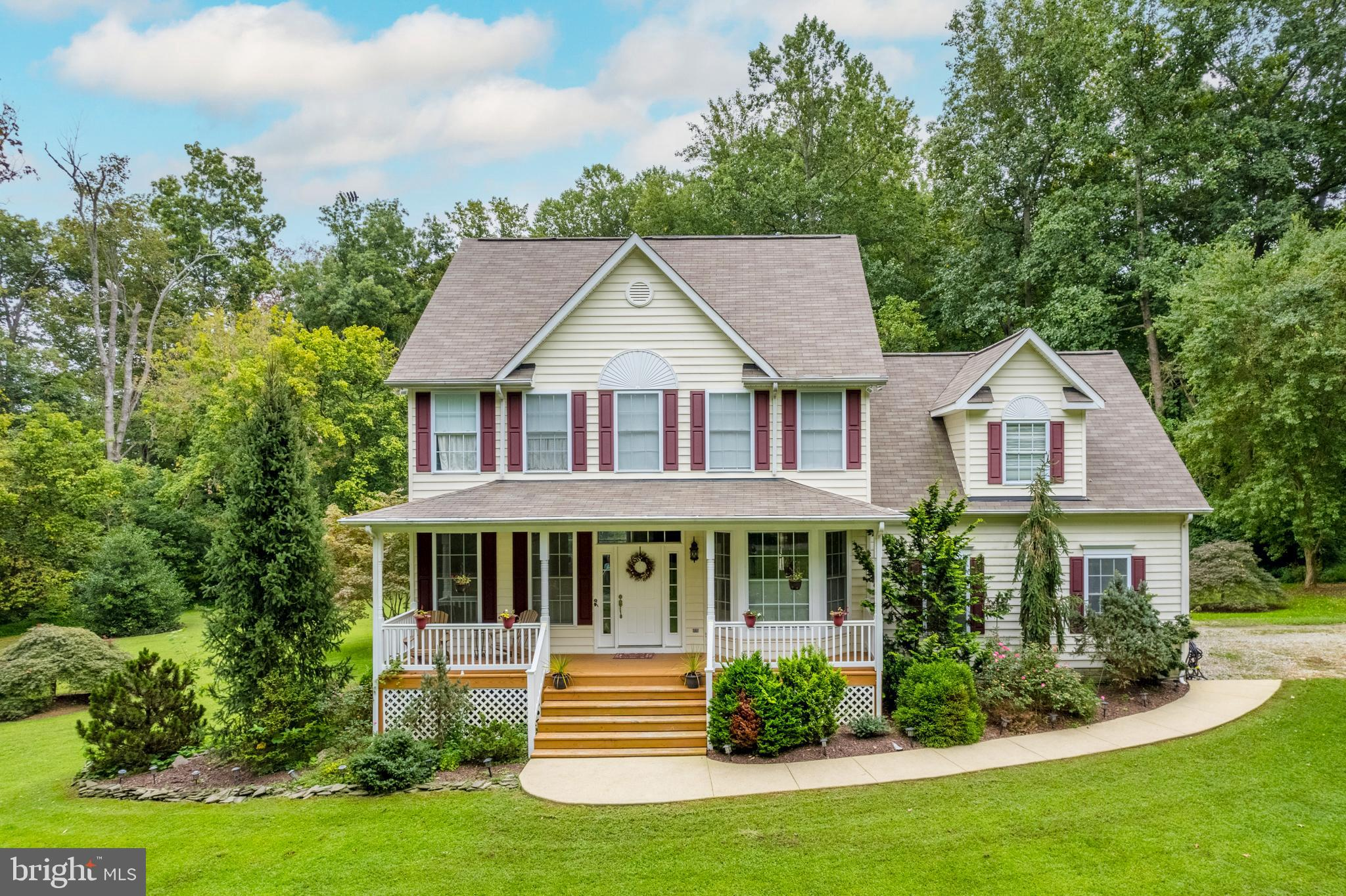 Welcome home to your own personal retreat located on 3+ scenic acres!  You will absolutely love the