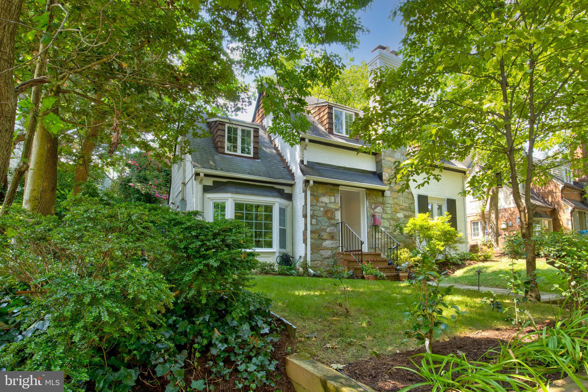 Update, renovate or expand this charming 1938 cottage home in the coveted community of Brookmont.  T