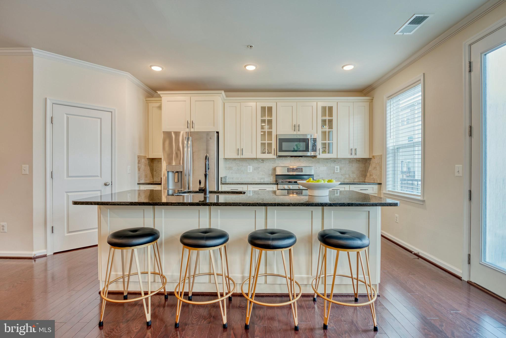 Built in 2018, this END-UNIT, modern home with an attached ONE-CAR GARAGE + driveway, is one of the