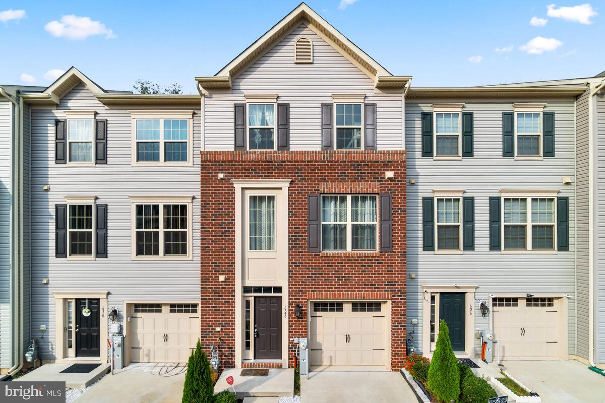 Stunning three-level townhome! This home makes a fantastic first impression with its beautiful brick