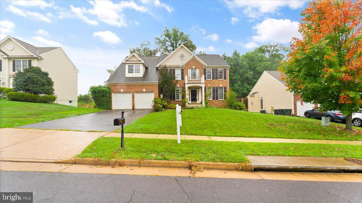 Gorgeous 3 Level Colonial, freshly painted, granite tops, stainless steel appliances, Walkout basement to patio, hardwood floors, spacious bedrooms, getting ready for move in!