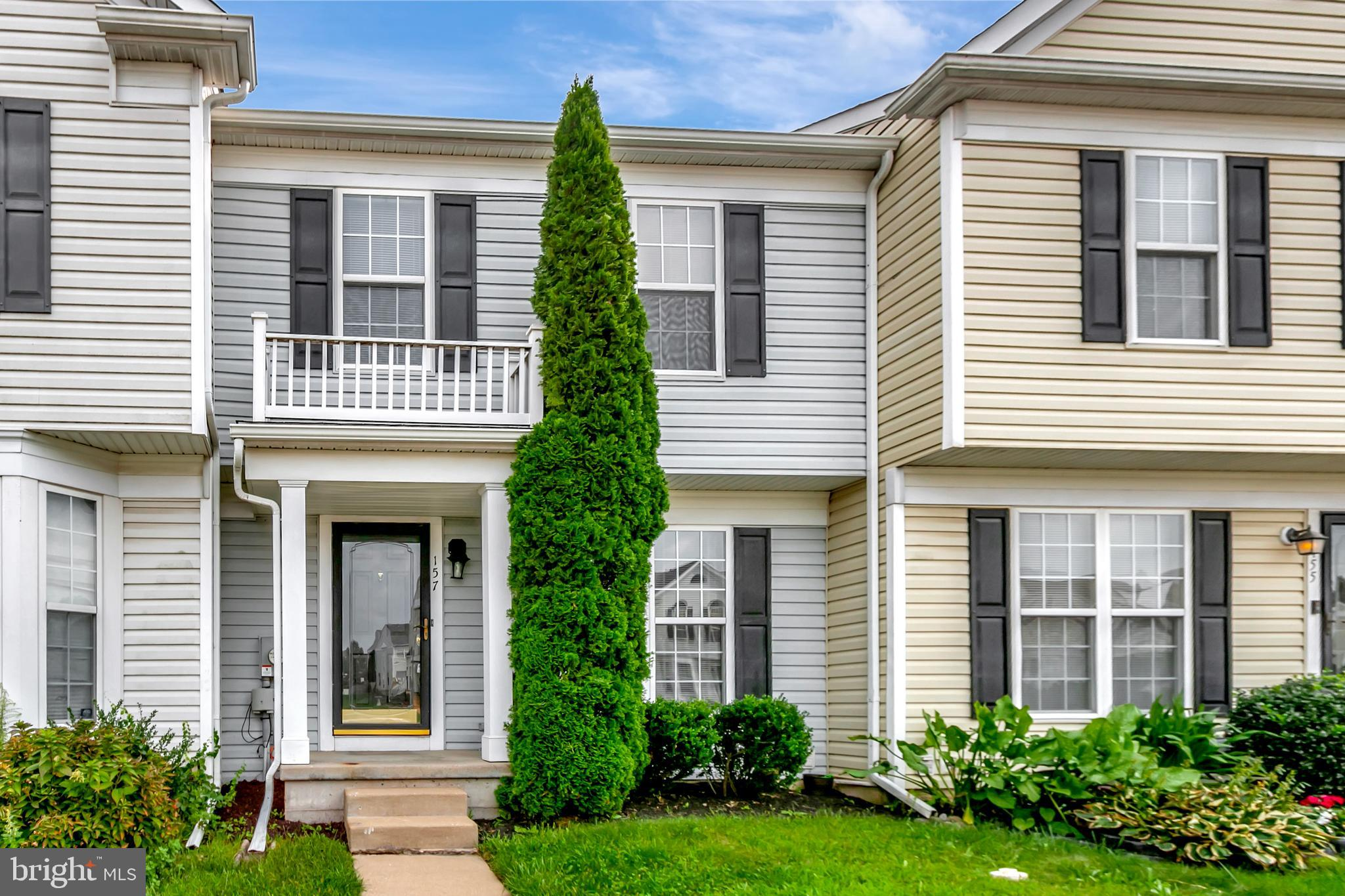 This spacious, move-in ready townhome is not one to miss. The first floor features a tiled entry lea