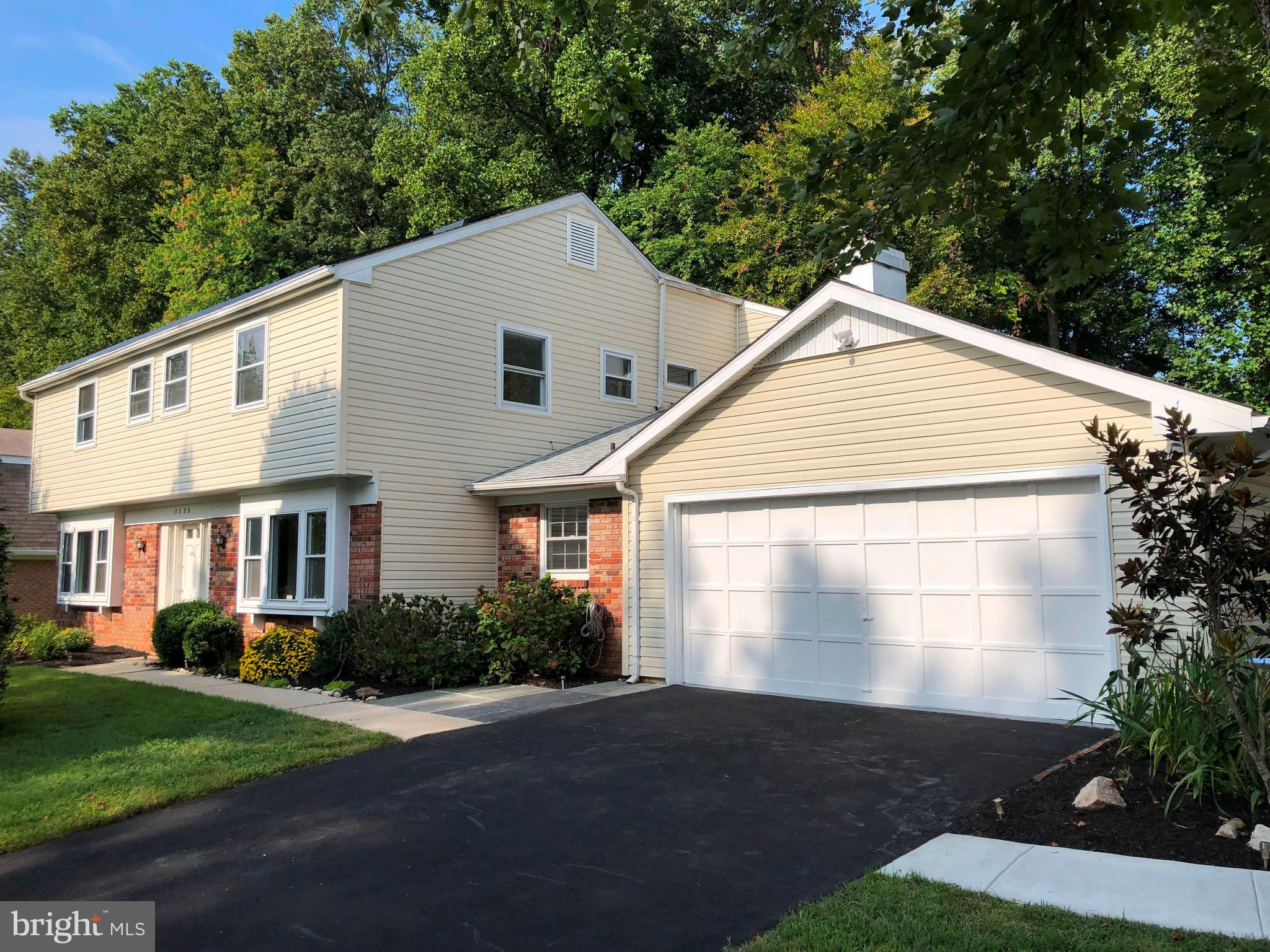 Beautiful upgraded and expanded center-hall colonial located on a choice .31-acre lot with private f