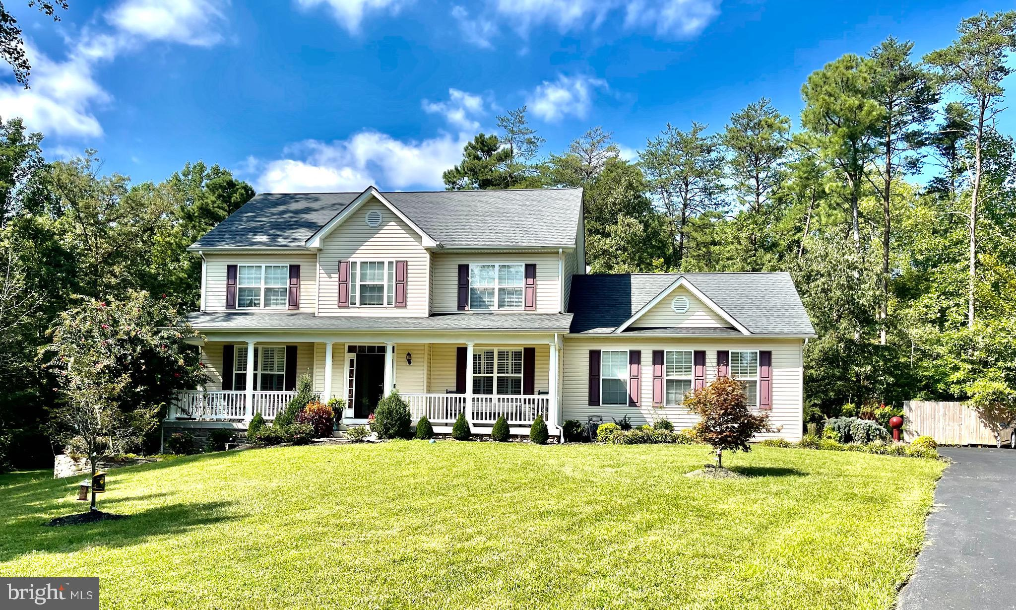 Beautiful home  sits on 3.51 acres  and backs to trees.    Large open front and back yard on a cul-d