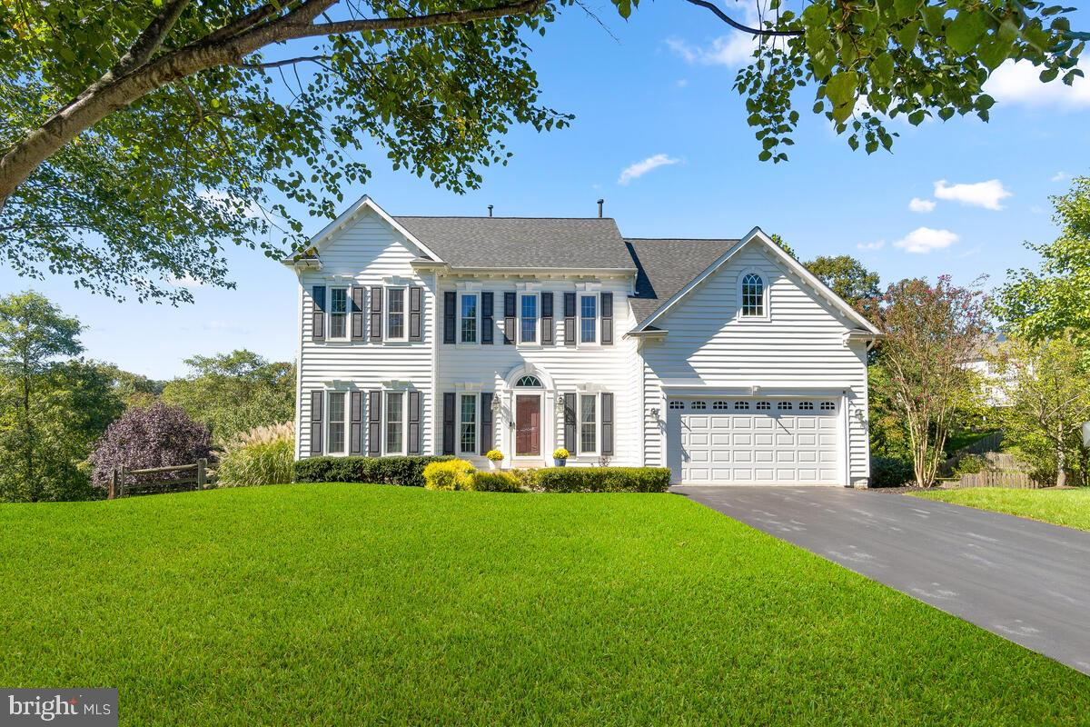 Welcome to one of the most scenic lots in popular Spring Ridge!  Discover this beautiful 4 bedroom,