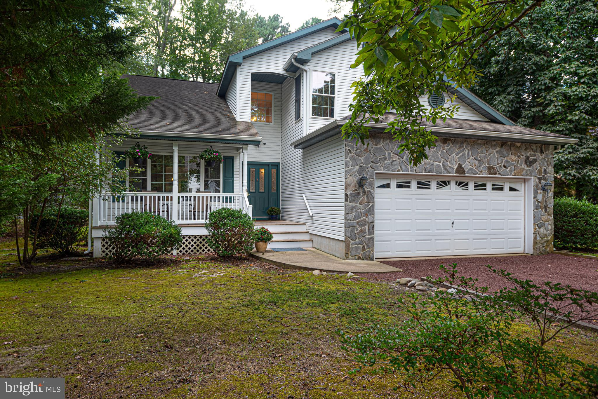 Stunning home on a beautiful oversized wooded lot in the highly sought after community of Ocean Pines.  Home has been beautifully updated, painted, and remodeled in October of 2019.  This home will go quickly!  Only two previous owners.  Nestled between two cul-de-sacs, this home is a rare gem.  It is minutes from Ocean City, Assateague Island, and all the wonderful amenities that Ocean Pines has to offer, but is so quiet and peaceful that you would never know it.  With waterproof Coretec flooring, Fabuwood self-closing cabinets, brushed nickel lighting fixtures and lever door handles, new carpeting, bar area pendant lighting, dining & kitchen recessed lighting, dimmer switches, Quartz countertops, skylights, French doors, lots of walk in closets & storage throughout, large walk in laundry room, double garage with utility sink, cathedral ceilings in master and throughout the home, ceiling fans throughout, large master suite, walk in attic spaces,  large screened porch and patio area with picnic table, all electric home, 80 gallon hot water tank, multiple zone HVAC system, attic air handler recently replaced in Sept. 2020, washer and dryer replaced in 2015.  Well maintained neighborhood, great neighbors, and so much more!