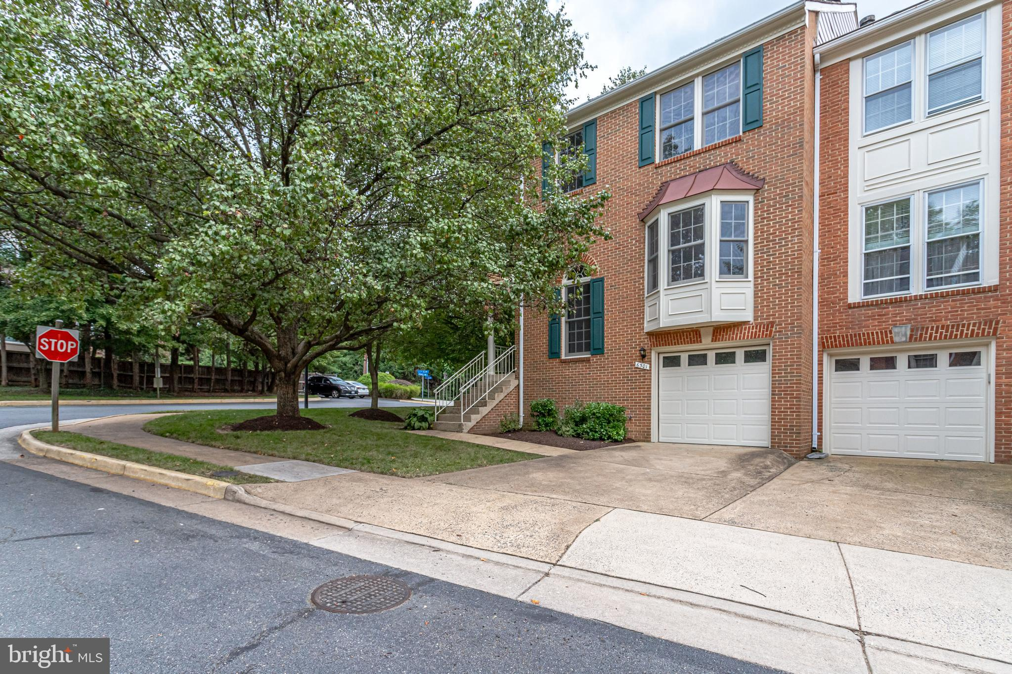 Step into this spacious, bright 3 bedrooms, 2 full baths, and 2 half baths brick garage townhome in the beautiful, quiet neighborhood of Seven Oaks Place. Tucked away in Falls Church, this home is less than one mile from the East Falls Church Metro and close to all the amenities of Seven Corners.  Warm hardwoods, large room sizes, plenty of natural light and crisp moldings create warm and inviting indoor space, while the corner lot, upper level deck, and lower level enclosed yard and patio all come together to provide a true urban oasis. On the main level you will find gleaming hardwood floors, a double-sided gas fireplace providing ambience for both the living and dining rooms, and a gourmet kitchen with plenty of counter space, stainless appliances, gas cooking, a breakfast bar, and an eating area. A half bath is located just off the living room and completes the main level. Upstairs you will find three bedrooms including the primary bedroom suite with vaulted ceilings, a walk-in closet, and a luxurious bath with a jacuzzi tub, separate shower, and dual sinks. 2 additional sizable bedrooms and a hall full bathroom complete the upper level. The lower level features a large family room with a wood-burning fireplace with access to the fully fenced back yard living space and patio. A second half bath is also located on the lower level, along with the laundry area and access to the one-car garage. Within minutes of this fabulous home are numerous options for great dining and shopping including the popular Mosaic District, Tysons, Seven Corners Falls Church City, and Clarendon. Commuters will appreciate the easy access to DC, Pentagon, the Metro, and bus stations. If you're looking for a quality home in a spectacular location, you've found it! Welcome Home!